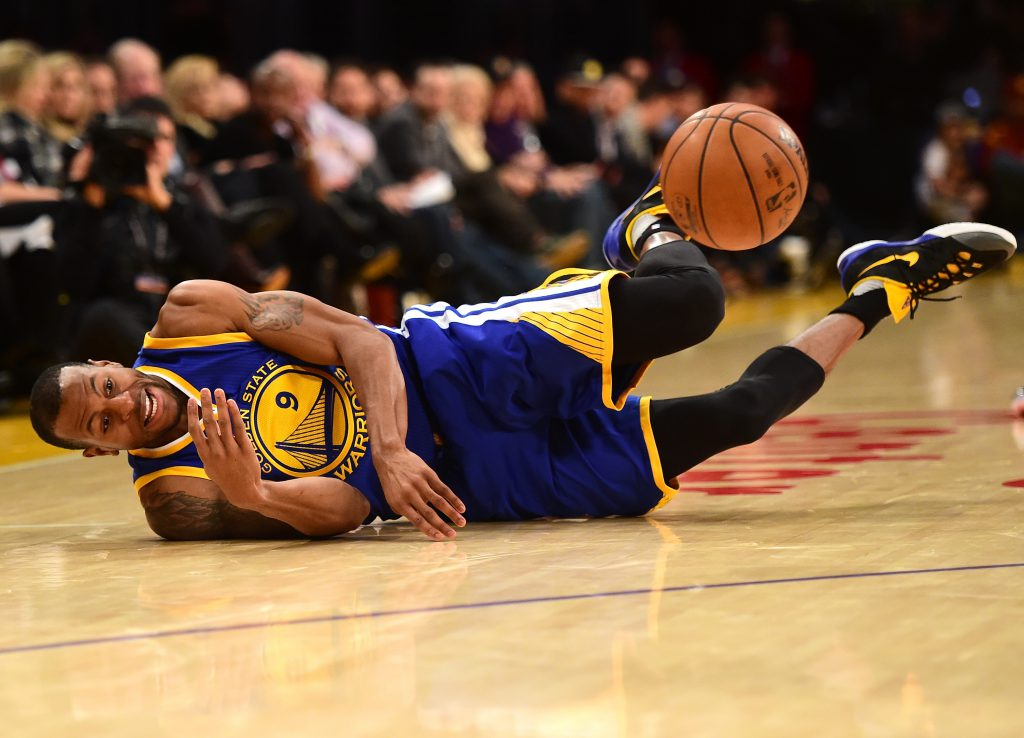 LOS ANGELES, CA - JANUARY 05: Andre Iguodala #9 of the Golden State Warriors dives for possession of the ball during a 109-88 win over the Los Angeles Lakers at Staples Center on January 5, 2016 in Los Angeles, California. NOTE TO USER: User expressly acknowledges and agrees that, by downloading and or using this Photograph, user is consenting to the terms and condition of the Getty Images License Agreement. (Photo by Harry How/Getty Images)