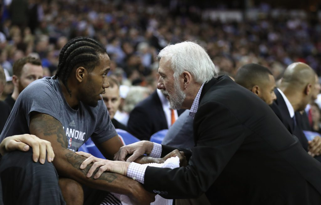 SACRAMENTO, CA - FEBRUARY 24: Head coach Gregg Popovich of the San Antonio Spurs talks to Kawhi Leonard #2 of the San Antonio Spurs during their game against the Sacramento Kings at Sleep Train Arena on February 24, 2016 in Sacramento, California. NOTE TO USER: User expressly acknowledges and agrees that, by downloading and or using this photograph, User is consenting to the terms and conditions of the Getty Images License Agreement. (Photo by Ezra Shaw/Getty Images)