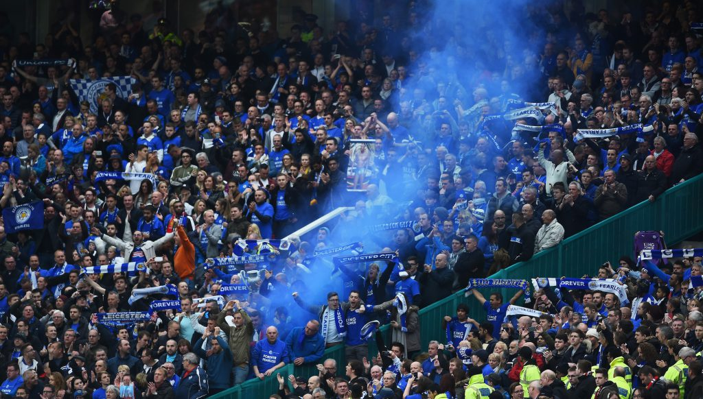MANCHESTER, UNITED KINGDOM - MAY 01: A flare is let off by Leicester fans during the Barclays Premier League match between Manchester United and Leicester City at Old Trafford on May 1, 2016 in Manchester, England. (Photo by Laurence Griffiths/Getty Images)
