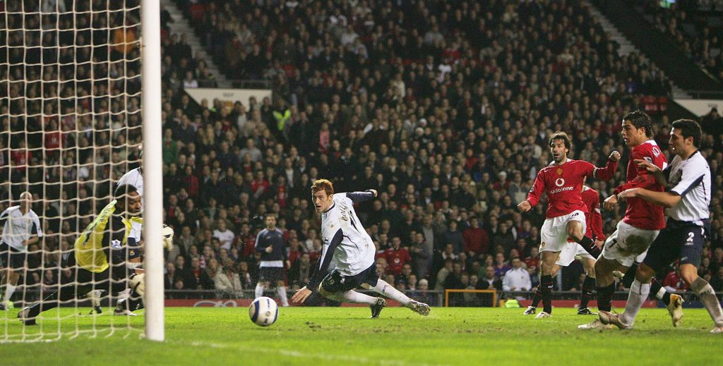 MANCHESTER, UNITED KINGDOM - MARCH 29: Ruud van Nistelrooy of Manchester United scores the opening goal past Shaka Hislop of West Ham during the Barclays Premiership match between Manchester United and West Ham United at Old Trafford on March 29, 2006 in Manchester, England. (Photo by Laurence Griffiths/Getty Images)