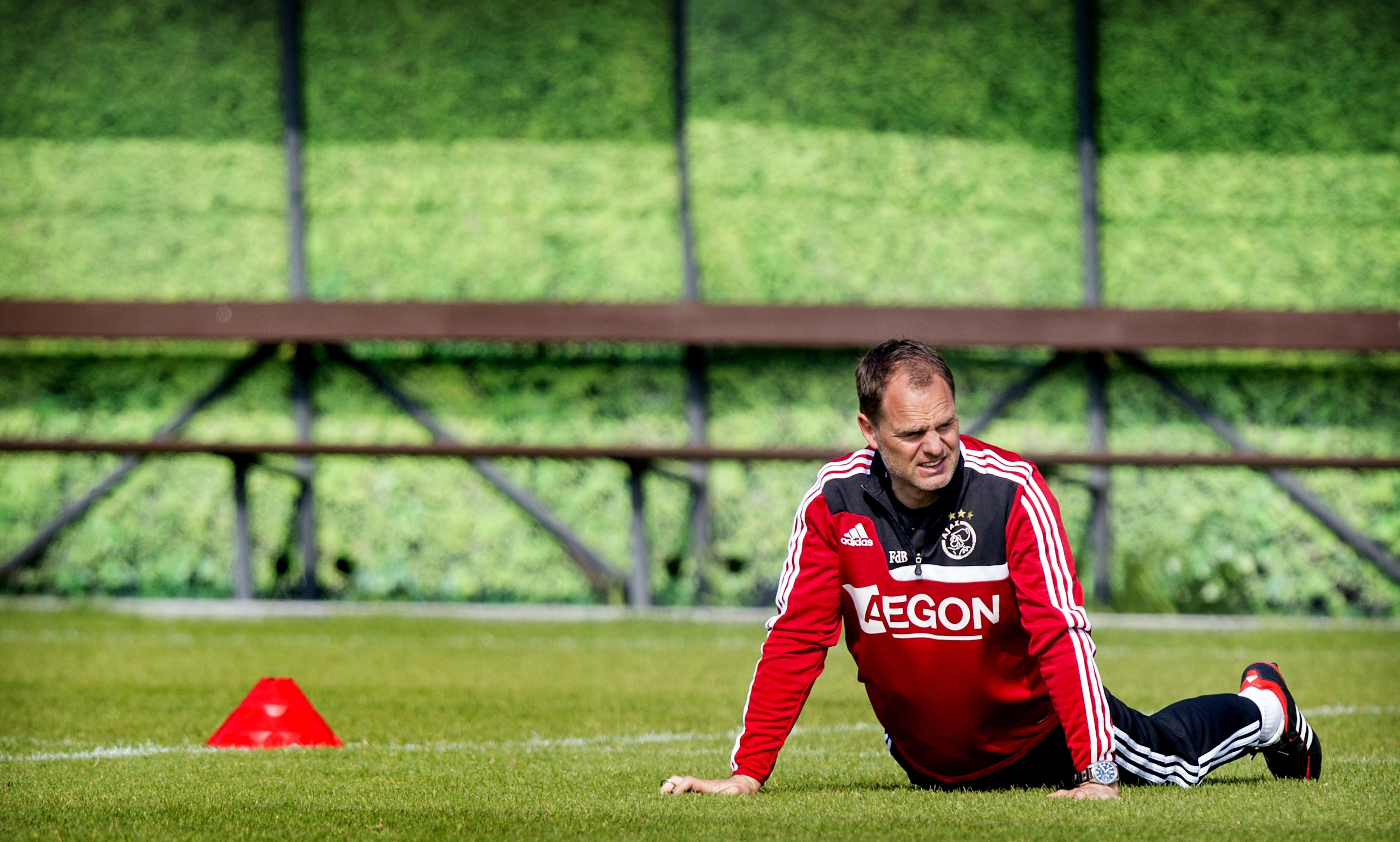 Ajax Amsterdam's head coach Frank de Boer warms up during a training session of the football team in Amsterdam, on April 25, 2014. Ajax will face Heracles Almelo on April 27. Ajax leads the Dutch First League. AFP PHOTO / ANP KOEN VAN WEEL - Netherlands out - Belgium out (Photo credit should read Koen van Weel/AFP/Getty Images)