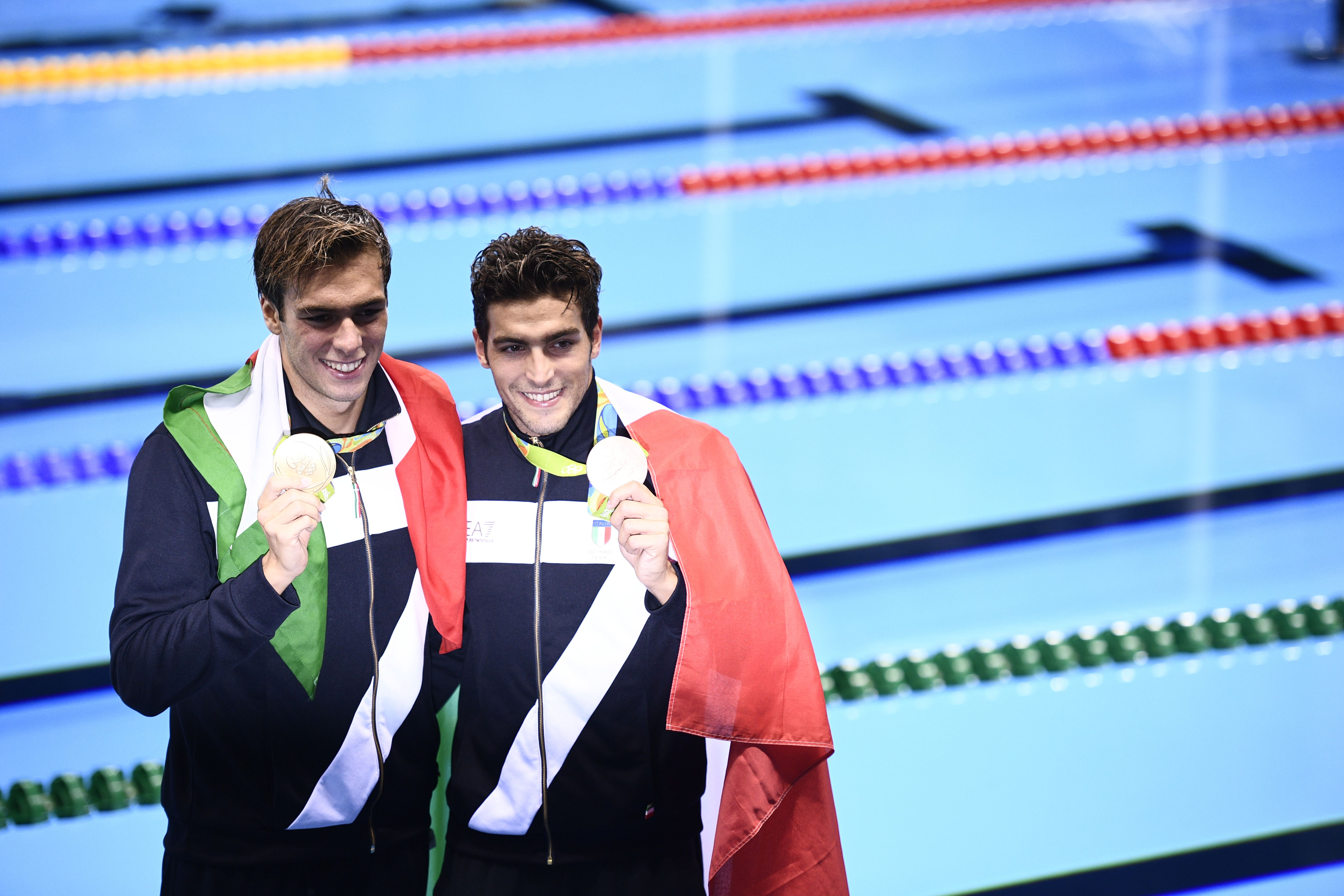 Italy's gold medallist Gregorio Paltrinieri and Italy's bronze Gabriele Detti (R) pose on the podium after the Men's swimming 1500m Freestyle Final at the Rio 2016 Olympic Games at the Olympic Aquatics Stadium in Rio de Janeiro on August 13, 2016. / AFP / Martin BUREAU (Photo credit should read MARTIN BUREAU/AFP/Getty Images)