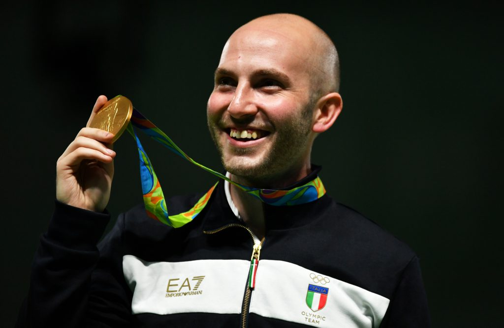 Gold medal Italy's Niccolo' Campriani celebrates on the podium during the medal ceremony for the 50m Rifle 3 positions men's Finals shooting event at the Rio 2016 Olympic Games at the Olympic Shooting Centre in Rio de Janeiro on August 14, 2016. / AFP / PASCAL GUYOT        (Photo credit should read PASCAL GUYOT/AFP/Getty Images)