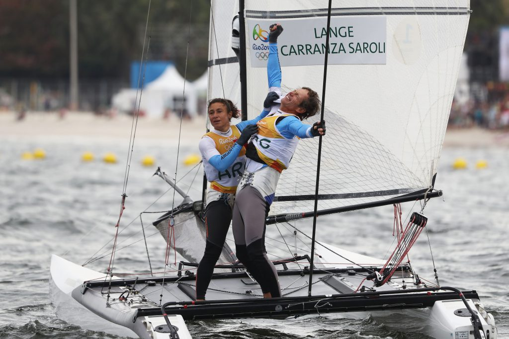 RIO DE JANEIRO, BRAZIL - AUGUST 16: Santiago Lange of Argentina and Cecilia Carranza Saroli of Argentina celebrate winning the gold medal in the Nacra 17 Mixed class on Day 11 of the Rio 2016 Olympic Games at the Marina da Gloria on August 16, 2016 in Rio de Janeiro, Brazil. (Photo by Clive Mason/Getty Images)