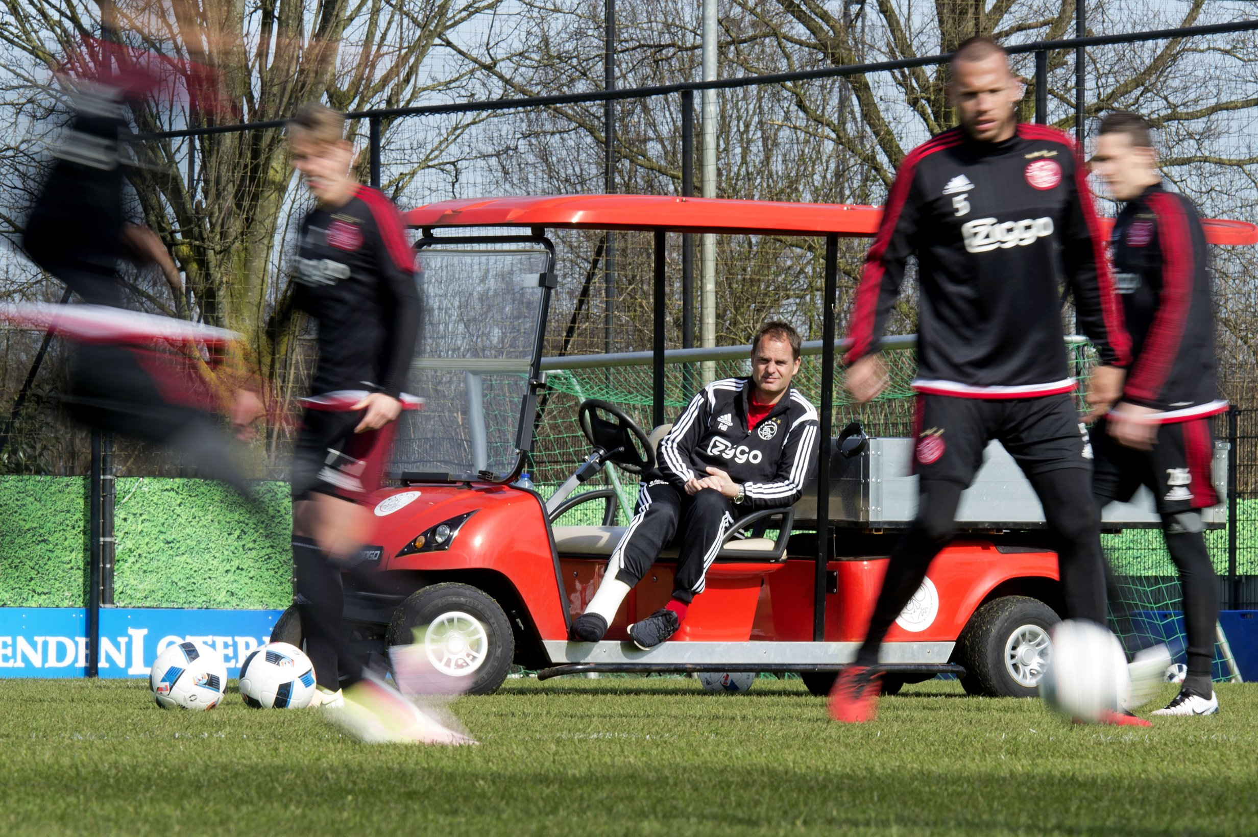 Ajax Amsterdam's head coach Frank De Boer, sitting on a golf cart because of a rupture of the Achilles tendon, attends the training session of his football team, in Amsterdam, on April 1, 2016. / AFP / ANP / OLAF KRAAK / Netherlands OUT (Photo credit should read OLAF KRAAK/AFP/Getty Images)