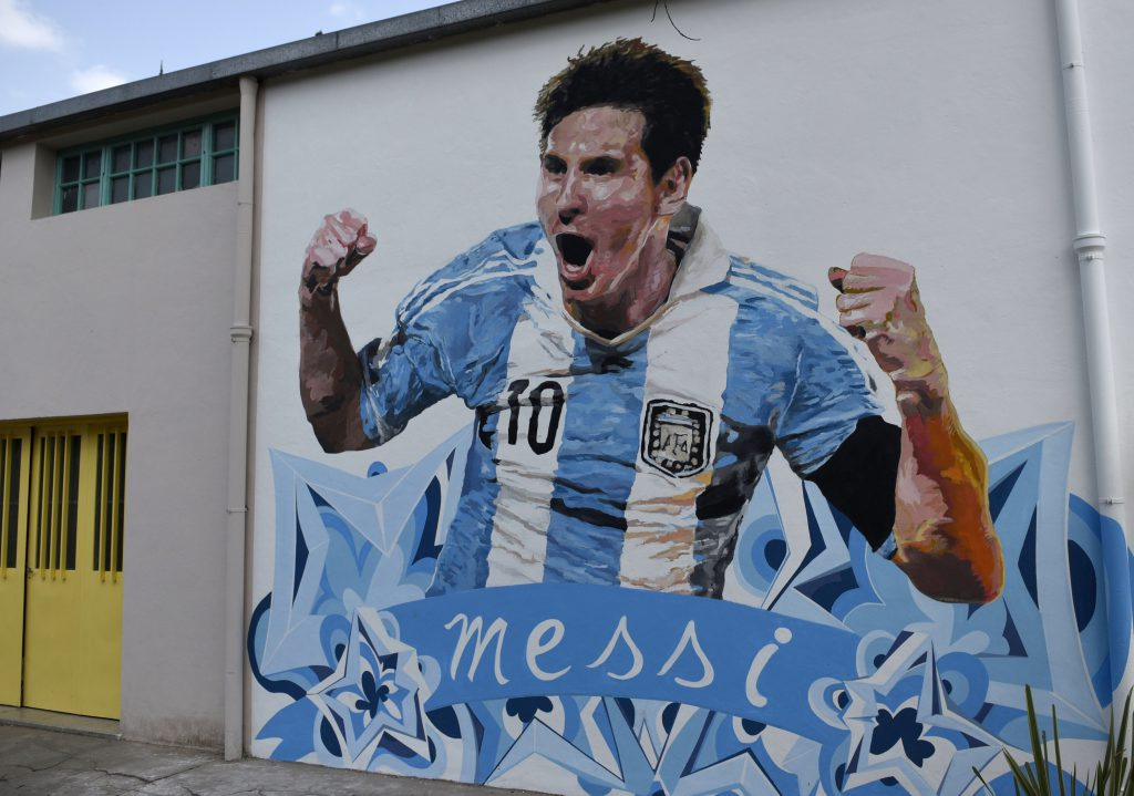 A mural of Argentine footballer Lionel Messi painted by Brazilian artist Paulo Consentino is seen on the wall of the backyard of the General Las Heras school in Rosario, some 350 km north of Buenos Aires, on August 26, 2015. AFP PHOTO / HECTOR RIO (Photo credit should read HECTOR RIO/AFP/Getty Images)