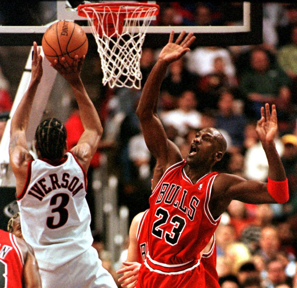 PHILADELPHIA, UNITED STATES: Chicago Bulls Michael Jordan (R) reacts as Philadelphia 76ers Allen Iverson goes up to the basket for two points in the game 15 January in Philadelphia, PA. Iverson's 31 points led the 76ers in their 106-96 upset of the world champion Bulls. AFP PHOTO TOM MIHALEK (Photo credit should read TOM MIHALEK/AFP/Getty Images)