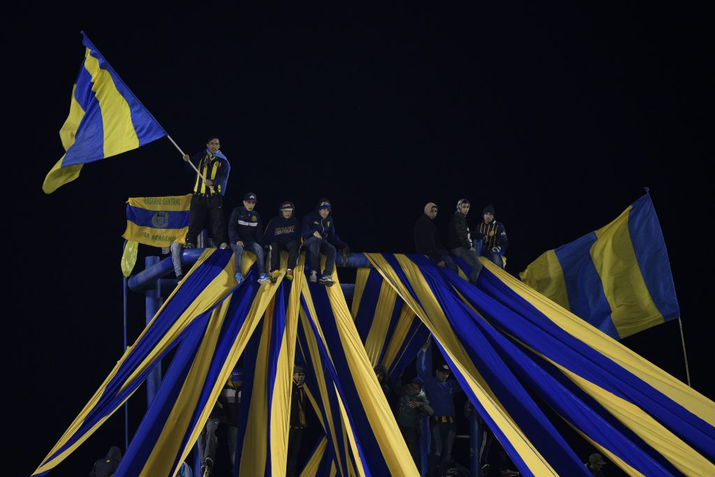 "Argentina's Rosario Central supporters cheer for their team during the Copa Libertadores 2016 quarterfinals first leg football match against Colombia's Atletico Nacional at the ""Gigante de Arroyito"" stadium in Rosario, Santa Fe, Argentina, on May 12, 2016. / AFP / JUAN MABROMATA (Photo credit should read JUAN MABROMATA/AFP/Getty Images)"