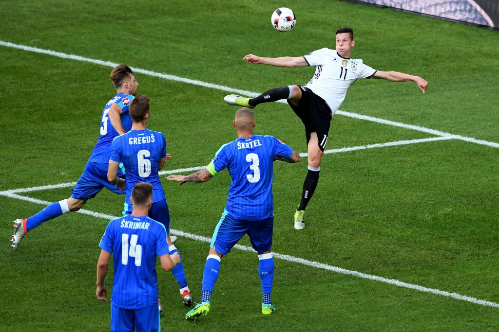 LILLE, FRANCE - JUNE 26: Julian Draxler (top) of Germany scores his team's third goal during the UEFA EURO 2016 round of 16 match between Germany and Slovakia at Stade Pierre-Mauroy on June 26, 2016 in Lille, France. (Photo by Matthias Hangst/Getty Images)