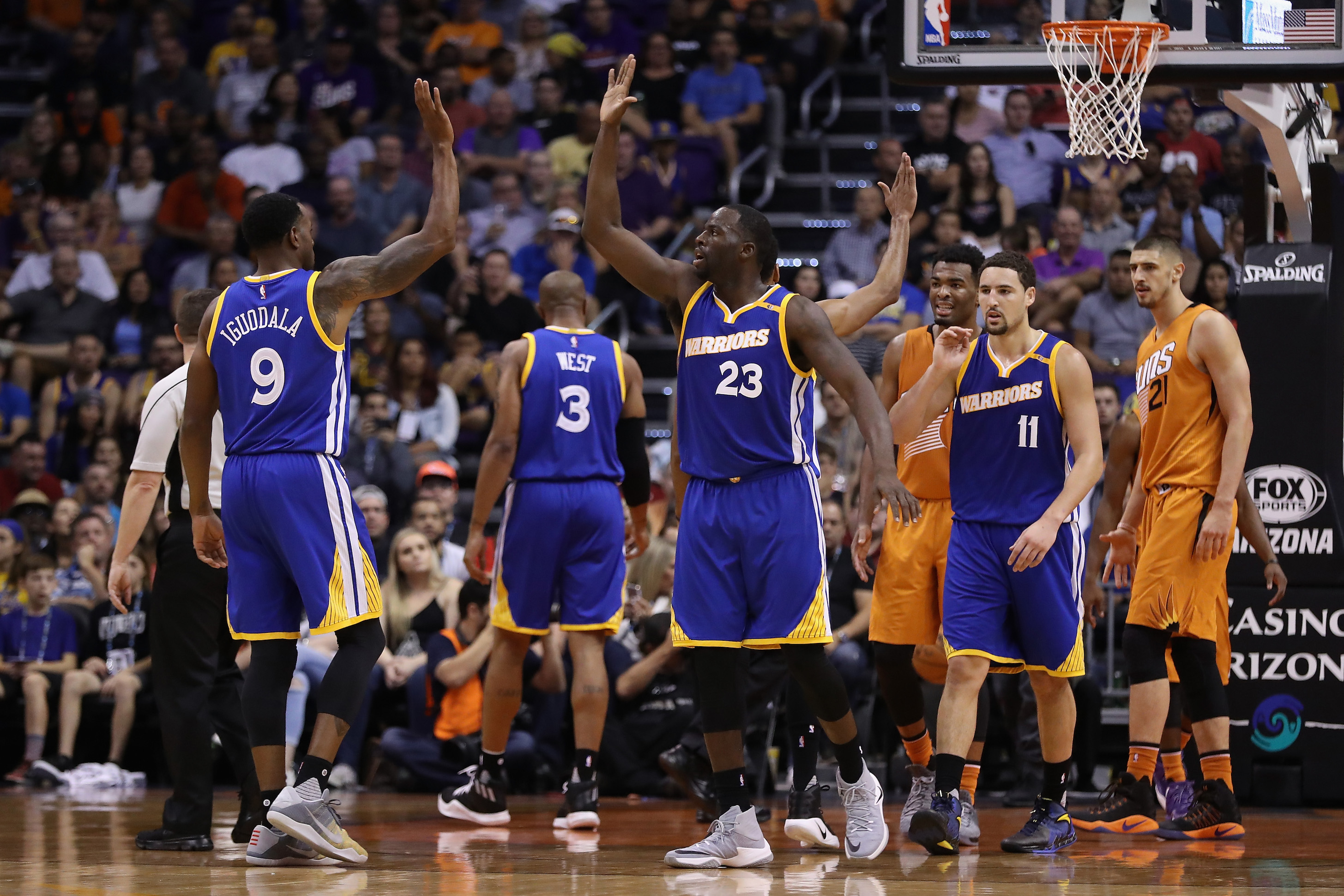 PHOENIX, AZ - OCTOBER 30: Draymond Green #23 of the Golden State Warriors high fives Andre Iguodala #9 after scoring against the Phoenix Suns during the second half of the NBA game at Talking Stick Resort Arena on October 30, 2016 in Phoenix, Arizona. The Warriors defeated the Suns 106 -100. NOTE TO USER: User expressly acknowledges and agrees that, by downloading and or using this photograph, User is consenting to the terms and conditions of the Getty Images License Agreement. (Photo by Christian Petersen/Getty Images)