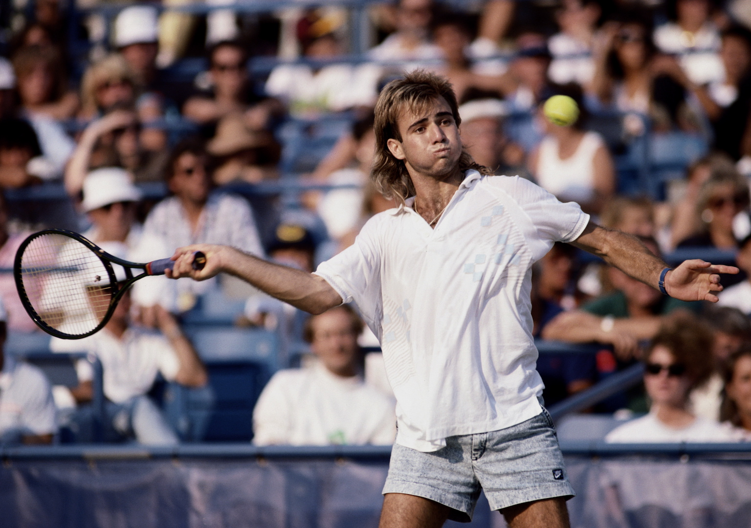 Andre Agassi of the United States wearing his jean style shorts during a Men's Singles match at the U.S.Open Tennis Championship on 1st September 1988 at the USTA National Tennis Center in the Flushing neighbourhood of Queens in New York, United States.(Photo by Mike Powell/Getty Images)