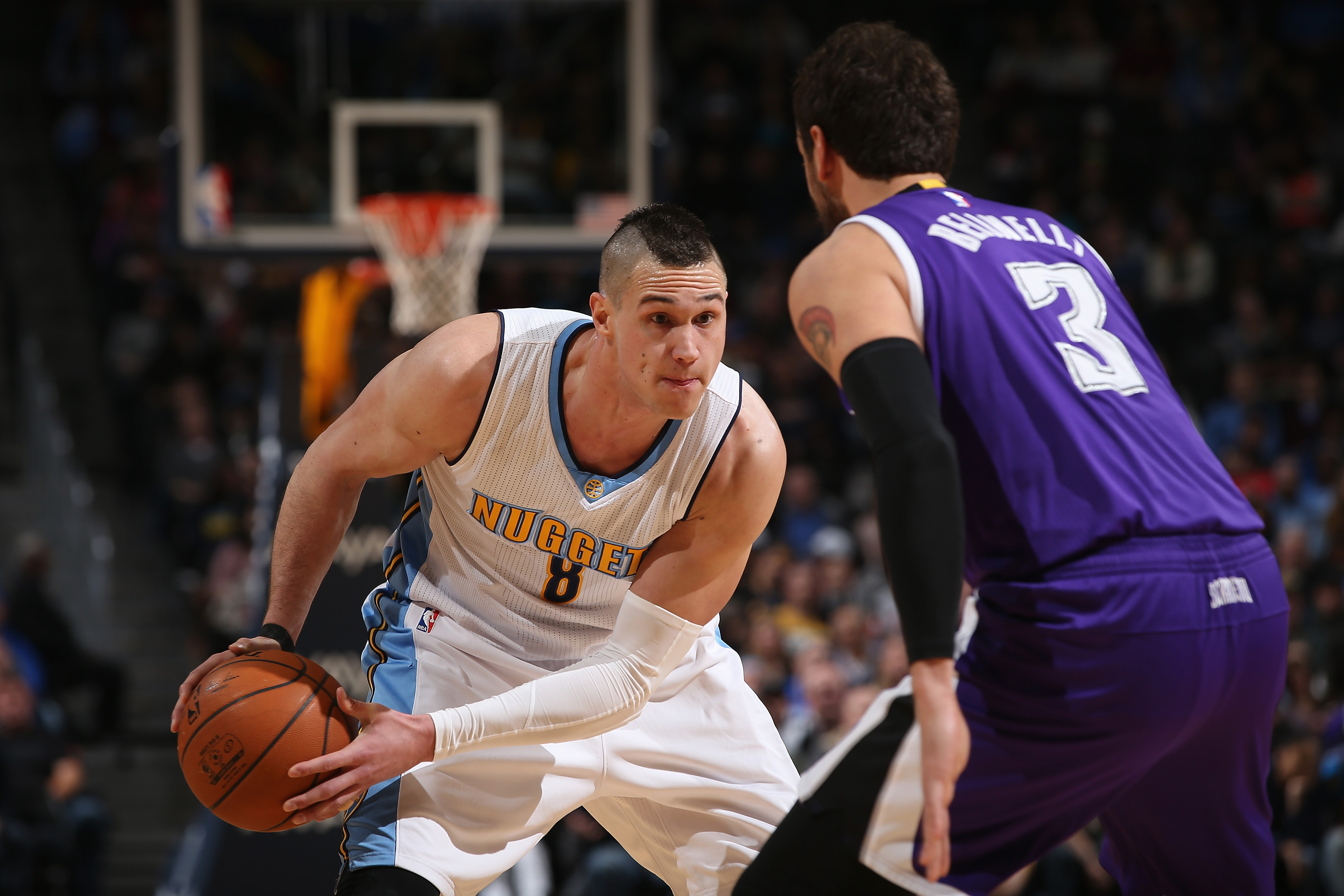 DENVER, CO - FEBRUARY 23: Danilo Gallinari #8 of the Denver Nuggets controls the ball against Marco Belinelli #3 of the Sacramento Kings at Pepsi Center on February 23, 2016 in Denver, Colorado. The Kings defeated the Nuggets 114-110. NOTE TO USER: User expressly acknowledges and agrees that, by downloading and or using this photograph, User is consenting to the terms and conditions of the Getty Images License Agreement. (Photo by Doug Pensinger/Getty Images)