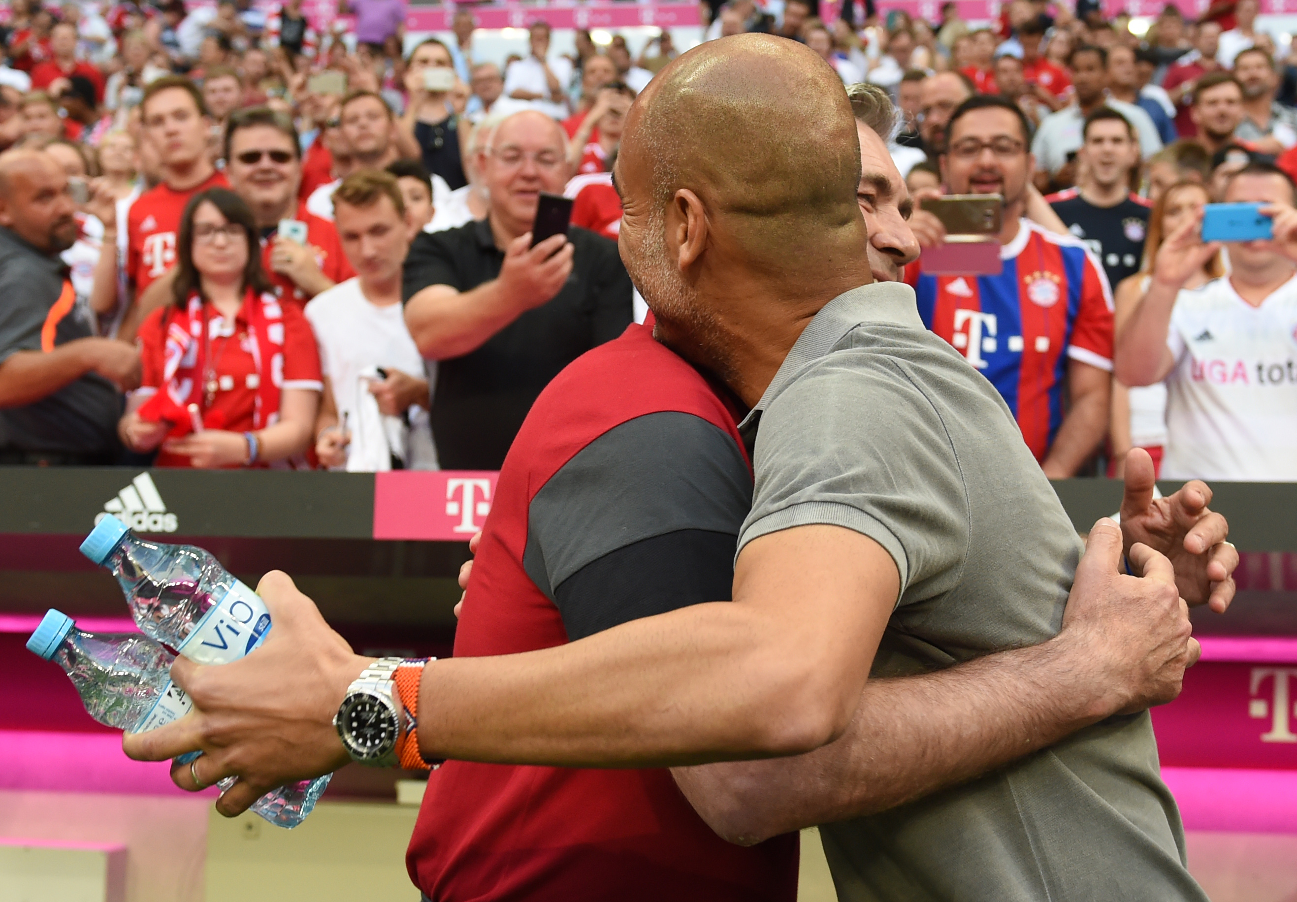 Bayern Munich's Italian headcoach Carlo Ancelotti (L) embraces Manchester's Spanish headcoach Pep Guardiola prior to a friendly soccer match between the German first division Bundesliga club FC Bayern Munich and the Premier League football team Manchester City in Munich, southern Germany, on July 20, 2016. / AFP / CHRISTOF STACHE (Photo credit should read CHRISTOF STACHE/AFP/Getty Images)