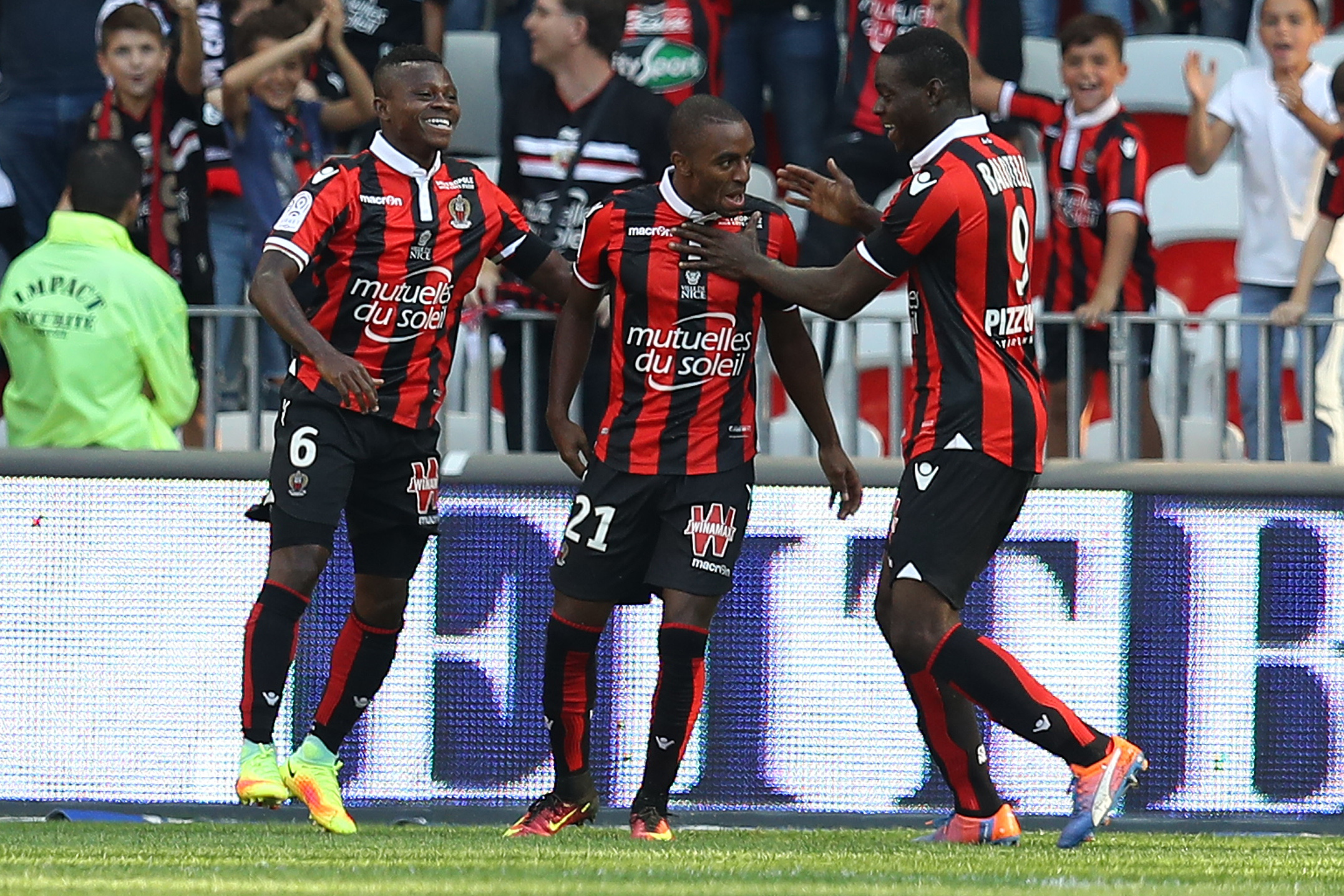 "Nice's Portuguese defender Ricardo Pereira (C) celebrates after scoring a goal with team mates Ivorian midfielder Jean Michael Seri (L) and Italian forward Mario Balotelli (R) during a French L1 football match between Nice (OGCN) and Lorient (FCL) on October 2, 2016 at the ""Allianz Riviera"" stadium in Nice, southeastern France. / AFP / VALERY HACHE (Photo credit should read VALERY HACHE/AFP/Getty Images)"