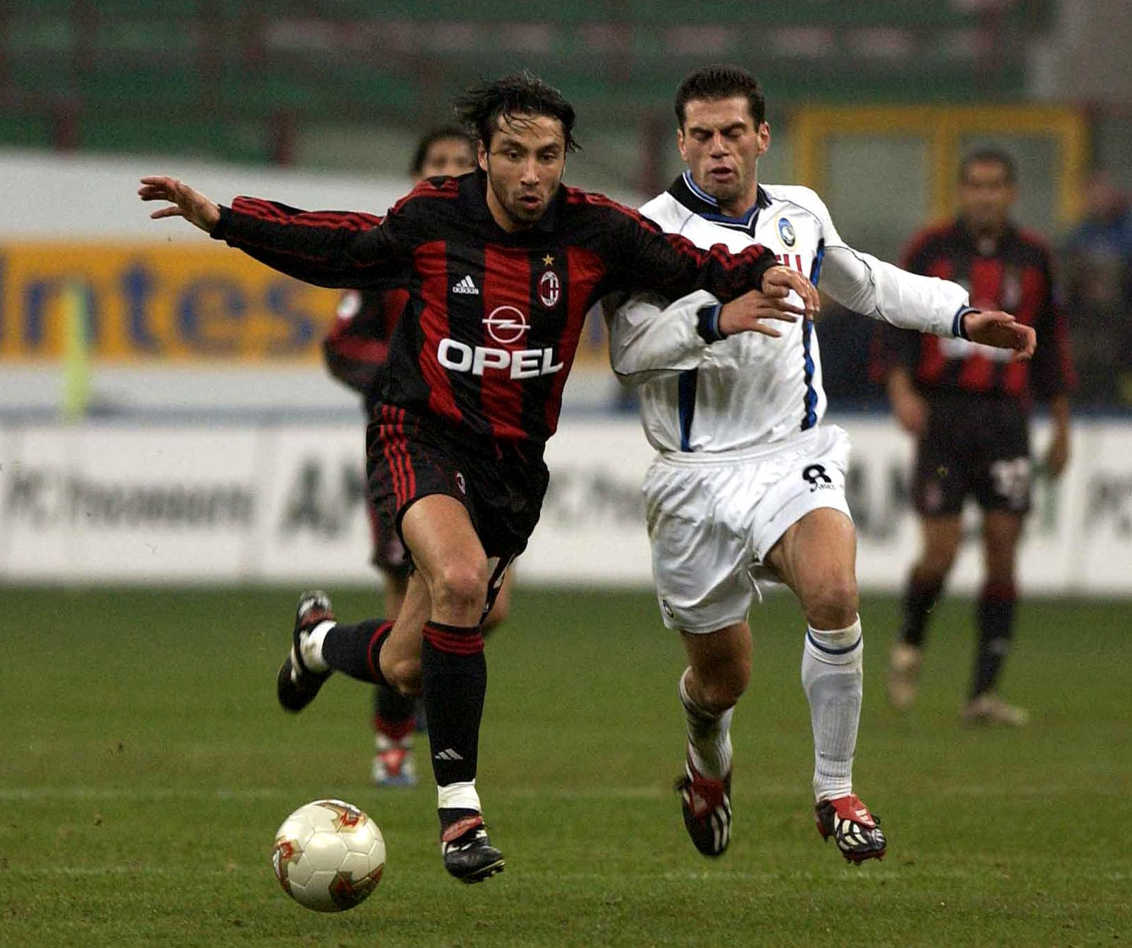 16 Feb 2002: Jose Mari of AC Milan and Luciano Zauri of Atalanta during the Serie A match between AC Milan and Atalanta, played at the San Siro Stadium, Milan. DIGITAL IMAGE Mandatory Credit: Grazia Neri/Getty Images