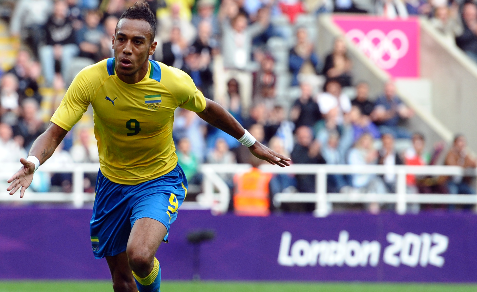 Gabon's Pierre Aubameyang celebrates after scoring during the 2012 Olympic mens football match between Gabon and Switzerland at St James' Park in Newcastle-upon-Tyne, north-east England on July 26, 2012. AFP PHOTO/PAUL ELLIS (Photo credit should read PAUL ELLIS/AFP/GettyImages)