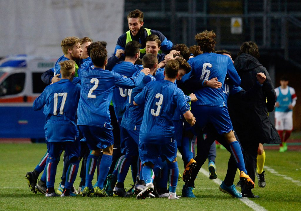PADOVA, ITALY - MARCH 27: Paolo Ghiglione of Italy U19 is mobbed by team mates after scoring his team's opening goal during the UEFA European U19 Championship Elite Round match between Italy and Switzerland at Stadio Euganeo on March 27, 2016 in Padova, Italy. (Photo by Dino Panato/Getty Images)