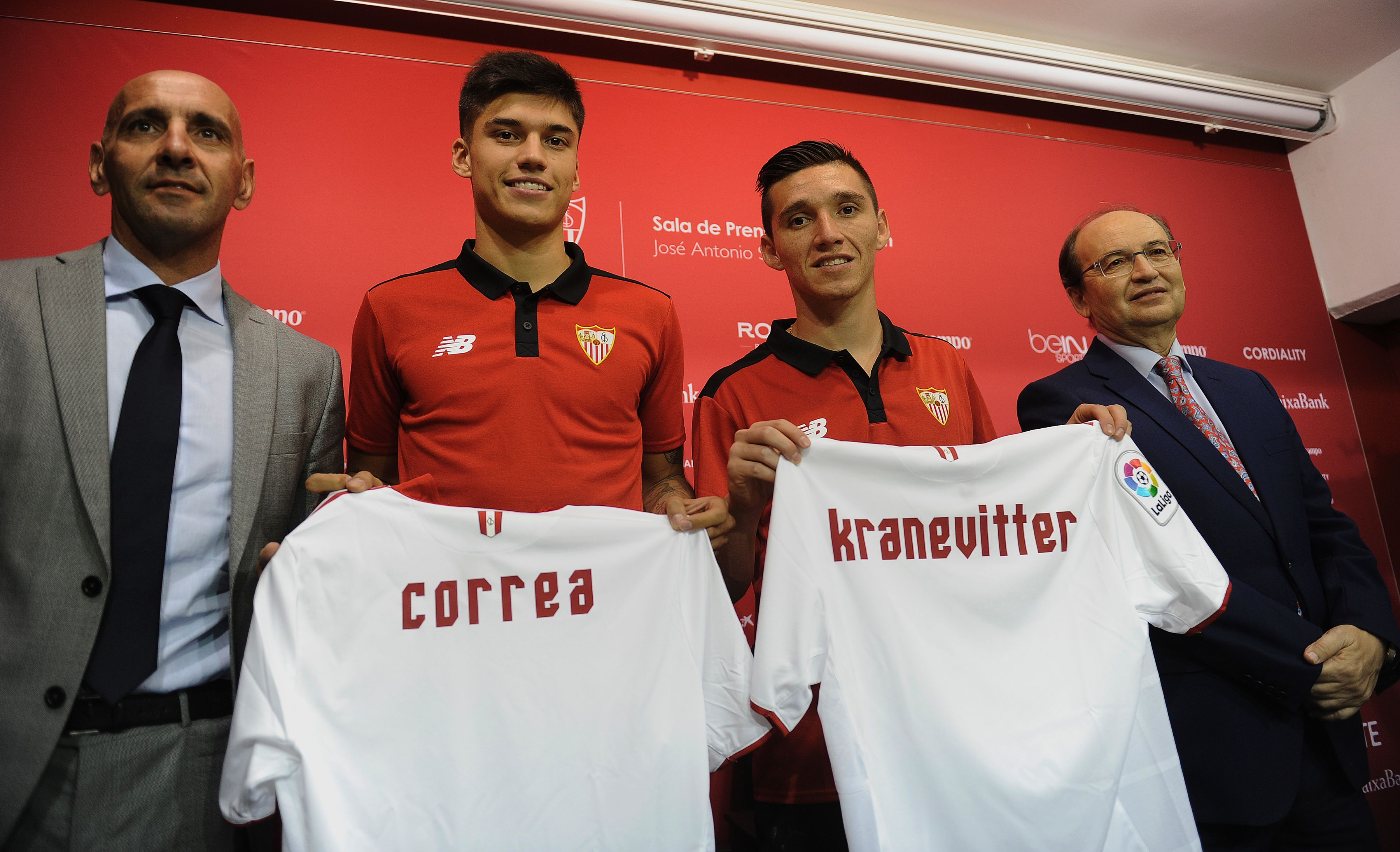 New Sevilla's Argentinian midfielders Matias Kranevitter (2ndR) and Joaquin Correa (2ndL) pose with Sevilla's President Jose Castro (R) and technical director Monchi during their official presentation at the Ramon Sanchez Pizjuan stadium in Sevilla on July 12, 2016. / AFP / CRISTINA QUICLER (Photo credit should read CRISTINA QUICLER/AFP/Getty Images)