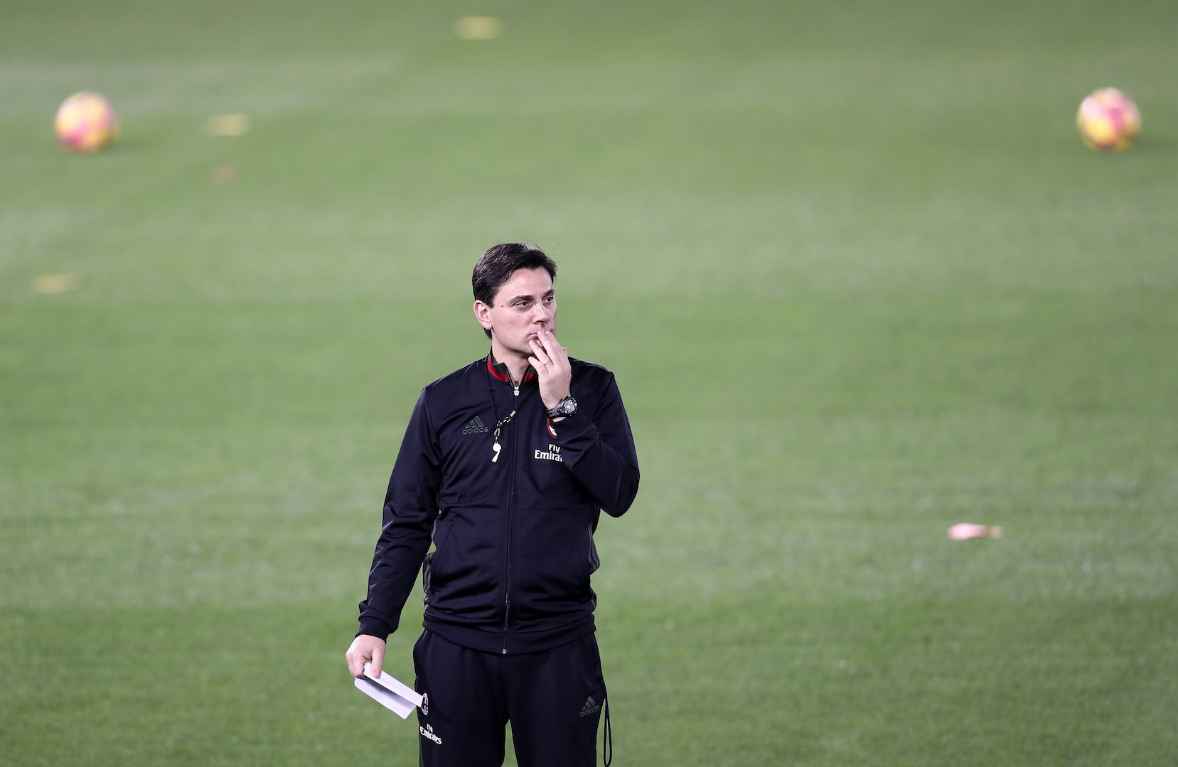 AC Milan's Italian head coach Vincenzo Montella monitors a training session in the Qatari capital Doha on December 22, 2016, on the eve of the Final of the Italian Super Cup between AC Milan and Juventus. / AFP / KARIM JAAFAR (Photo credit should read KARIM JAAFAR/AFP/Getty Images)