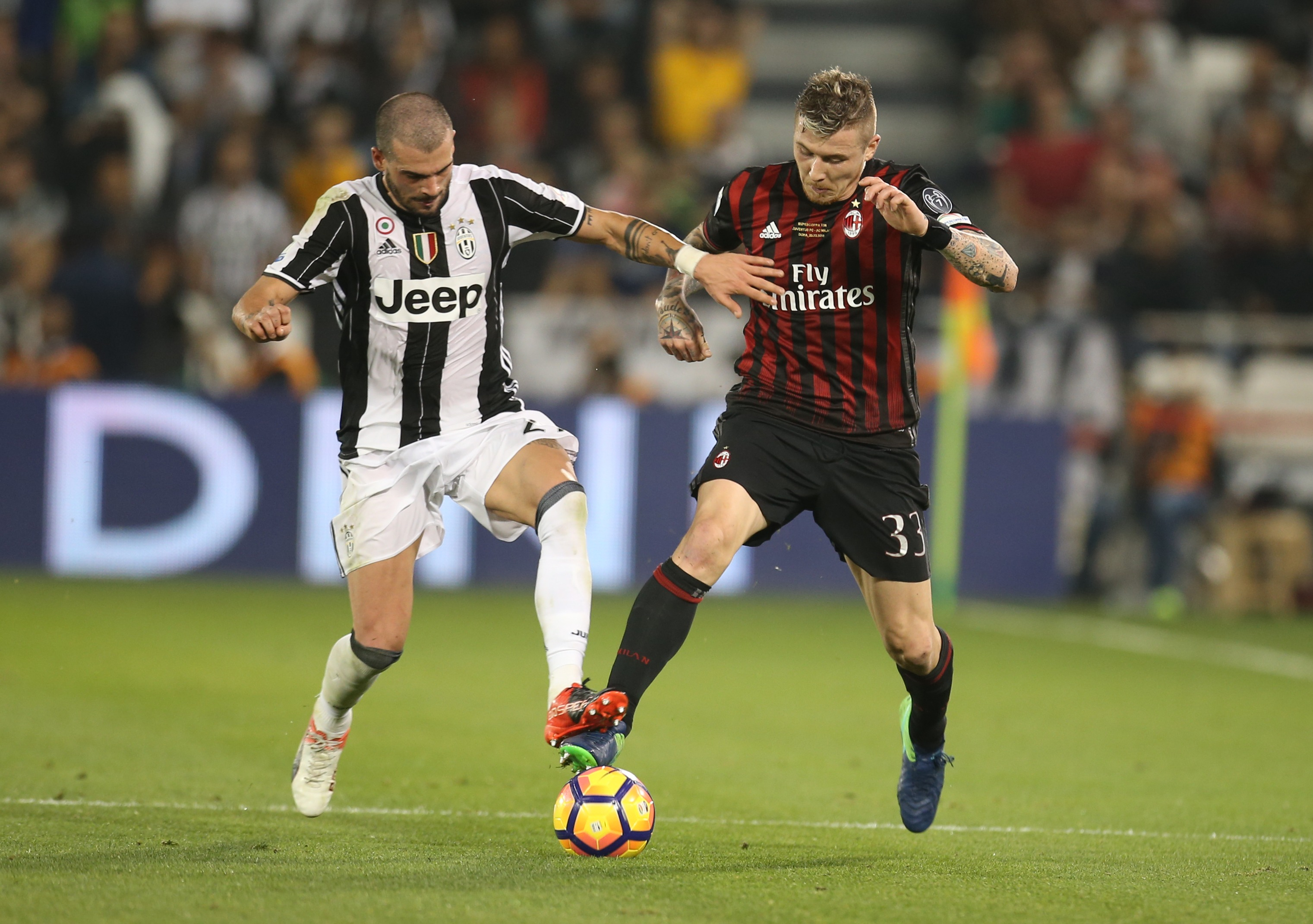 DOHA, QATAR - DECEMBER 23: Stefano Sturaro of Juventus FC in action against Juraj Kucka of AC Milan during the Supercoppa TIM Doha 2016 match between Juventus FC and AC Milan at the Jassim Bin Hamad Stadium on December 23, 2016 in Doha, Qatar. (Photo by AK BijuRaj/Getty Images)