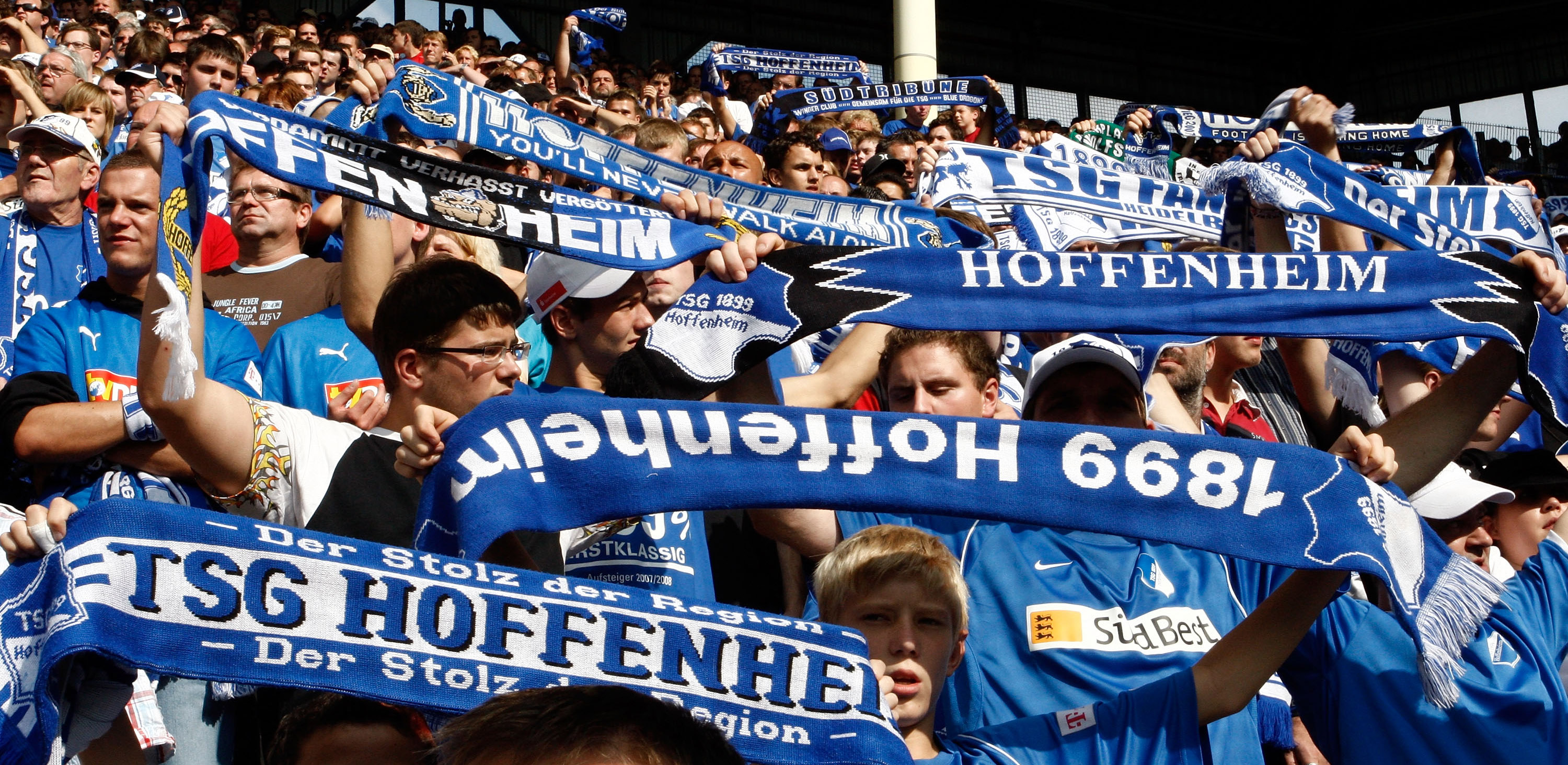 MANNHEIM, GERMANY - AUGUST 23: The Fans of TSG 1899 Hoffenheim celebrate after winning during the Bundesliga match TSG 1899 Hoffenheim against Borussia Moenchengladbach at the Carl Benz stadium in Mannheim on August 23, 2008 in Mannheim, Germany. (Photo by Thorsten Wagner/Bongarts/Getty Images)
