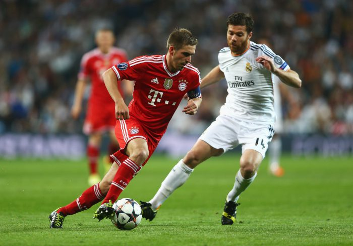 MADRID, SPAIN - APRIL 23: Philipp Lahm of Bayern Muenchen takes on Xabi Alonso of Real Madrid during the UEFA Champions League semi-final first leg match between Real Madrid and FC Bayern Muenchen at the Estadio Santiago Bernabeu on April 23, 2014 in Madrid, Spain. (Photo by Paul Gilham/Getty Images)