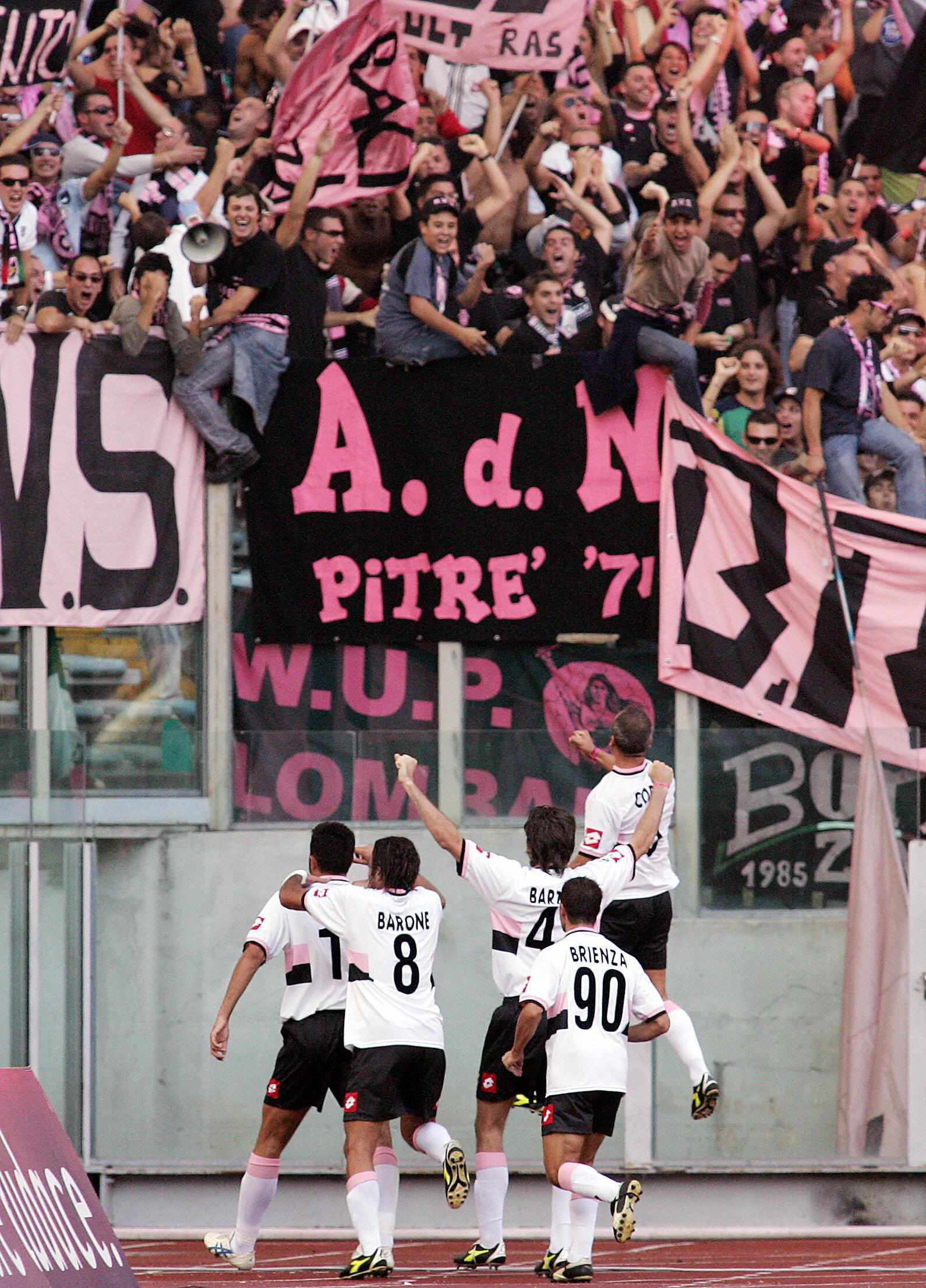 Palermo players celebrate with their fan