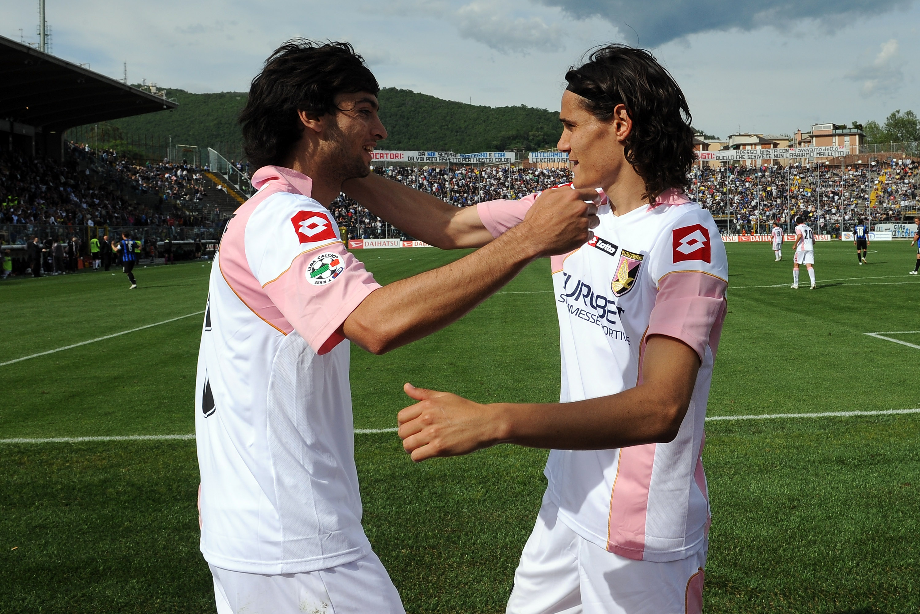 BERGAMO, ITALY - MAY 16: Edinson Cavani (R) of Palermo celebrates with his team mate Javier Pastore after scoring a penalty (1:2) during the Serie A match between Atalanta BC and US Citta di Palermo at Stadio Atleti Azzurri d'Italia on May 16, 2010 in Bergamo, Italy. (Photo by Tullio M. Puglia/Getty Images)
