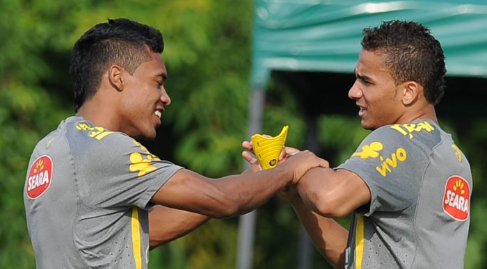 Brazilian U-20 national football players Alex Sandro (L) and Danilo joke during a training session in Barranquilla, Colombia, on July 31, 2011. Brazil will face Egypt, Panama and Austria in the Group E during the FIFA Under-20 World Cup. AFP PHOTO/VANDERLEI ALMEIDA (Photo credit should read VANDERLEI ALMEIDA/AFP/Getty Images)
