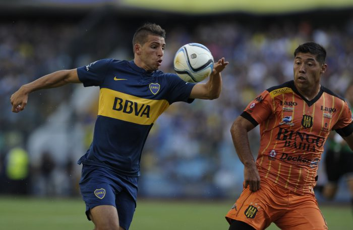 "Boca Juniors' forward Jonathan Calleri (L) vies for the ball with Olimpo's defender Nestor Moiraghi during their Argentine first division football match at ""La Bombonera"" stadium in Buenos Aires, Argentina, on February 15, 2014. AFP PHOTO / STR (Photo credit should read STR/AFP/Getty Images)"