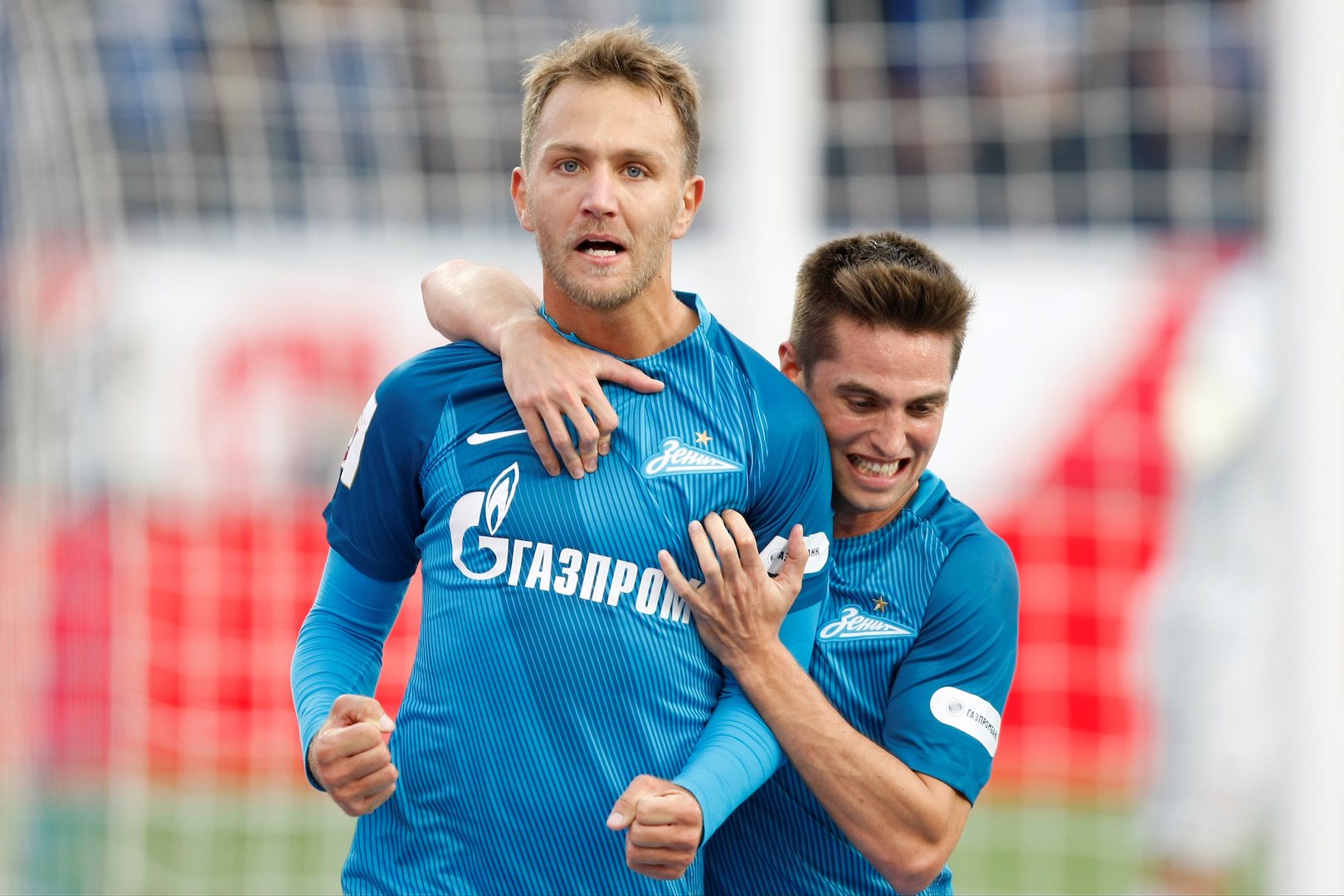 SAINT PETERSBURG, RUSSIA - OCTOBER 02: FC Zenit St. Petersburg players Domenico Criscito (L) celebrates with Robert Mak after scoring his goal during the Russian Football League match between FC Zenit St. Petersburg and FC Spartak Moscow at Petrovsky stadium on October 2, 2016 in St. Peterburg, Russia. (Photo by Epsilon/Getty Images)