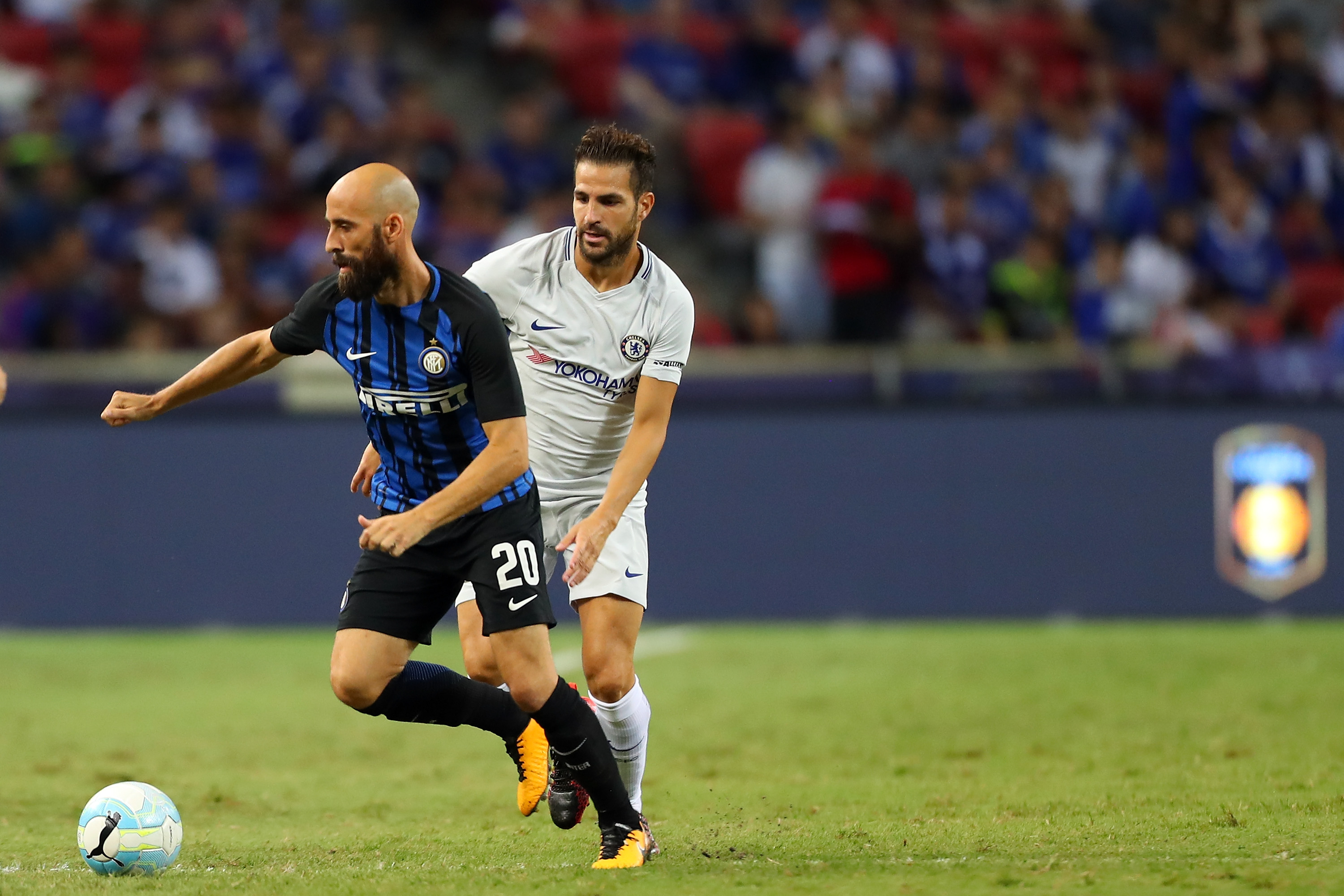 SINGAPORE - JULY 29: Borja Valero of FC Internazionale is checked by Cesc Fabregas of Chelsea FC during the International Champions Cup match between FC Internazionale and Chelsea FC at National Stadium on July 29, 2017 in Singapore. (Photo by Stanley Chou/Getty Images for ICC)