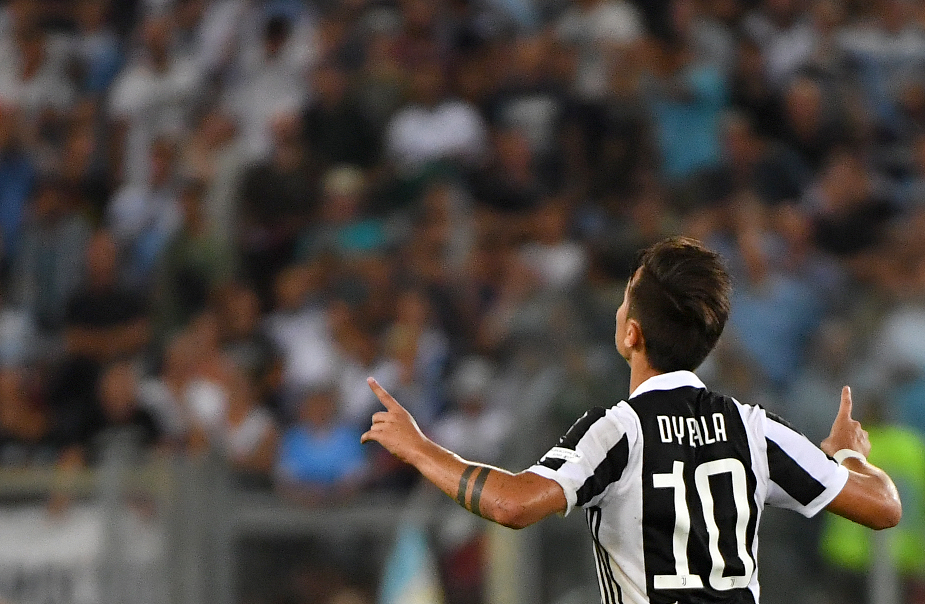 Juventus's forward from Argentina Paulo Dybala celebrates after scoring during the Italian SuperCup TIM football match Juventus vs lazio on August 13, 2017 at the Olympic stadium in Rome. / AFP PHOTO / ALBERTO PIZZOLI (Photo credit should read ALBERTO PIZZOLI/AFP/Getty Images)