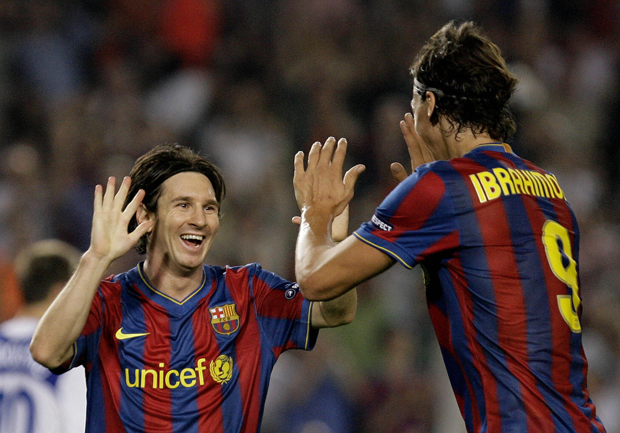 Barcelona's Argentinian forward Lionel Messi (L) is congratuled by his teammate Swedish forward Zlatan Ibrahimovic (R) after scoring during the UEFA Champions League football match between Barcelona and Dynamo Kiev at the Camp Nou stadium in Barcelona on September 29, 2009. AFP PHOTO/JOSEP LAGO (Photo credit should read JOSEP LAGO/AFP/Getty Images)
