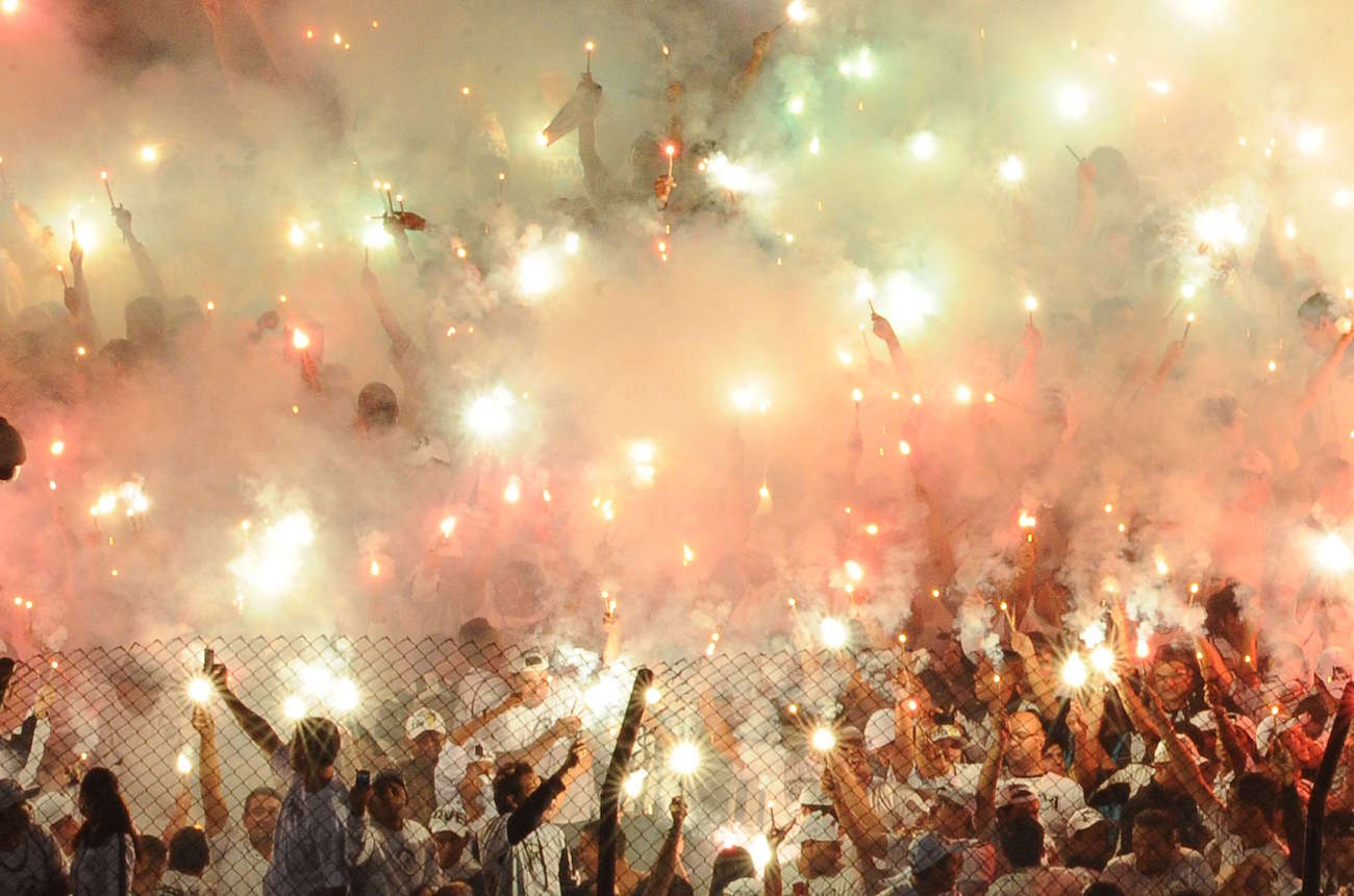 Santos fans celebrate before their match