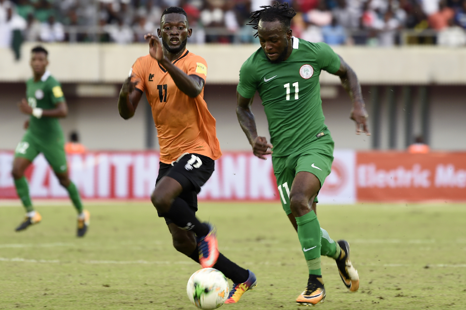 Nigerian attacker Victor Moses (R) tries to run past Zambia Chisamba Lungu during the FIFA World Cup 2018 qualifying football match between Nigeria and Zambia in Uyo, Akwa Ibom State, on October 7, 2017. / AFP PHOTO / PIUS UTOMI EKPEI (Photo credit should read PIUS UTOMI EKPEI/AFP/Getty Images)