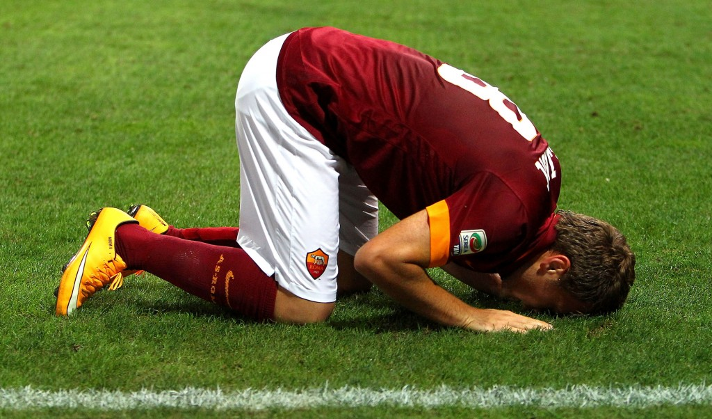 PARMA, ITALY - SEPTEMBER 24: Adem Ljajic of AS Roma celebrates after scoring the opening goal during the Serie A match between Parma FC and AS Roma at Stadio Ennio Tardini on September 24, 2014 in Parma, Italy. (Photo by Marco Luzzani/Getty Images)
