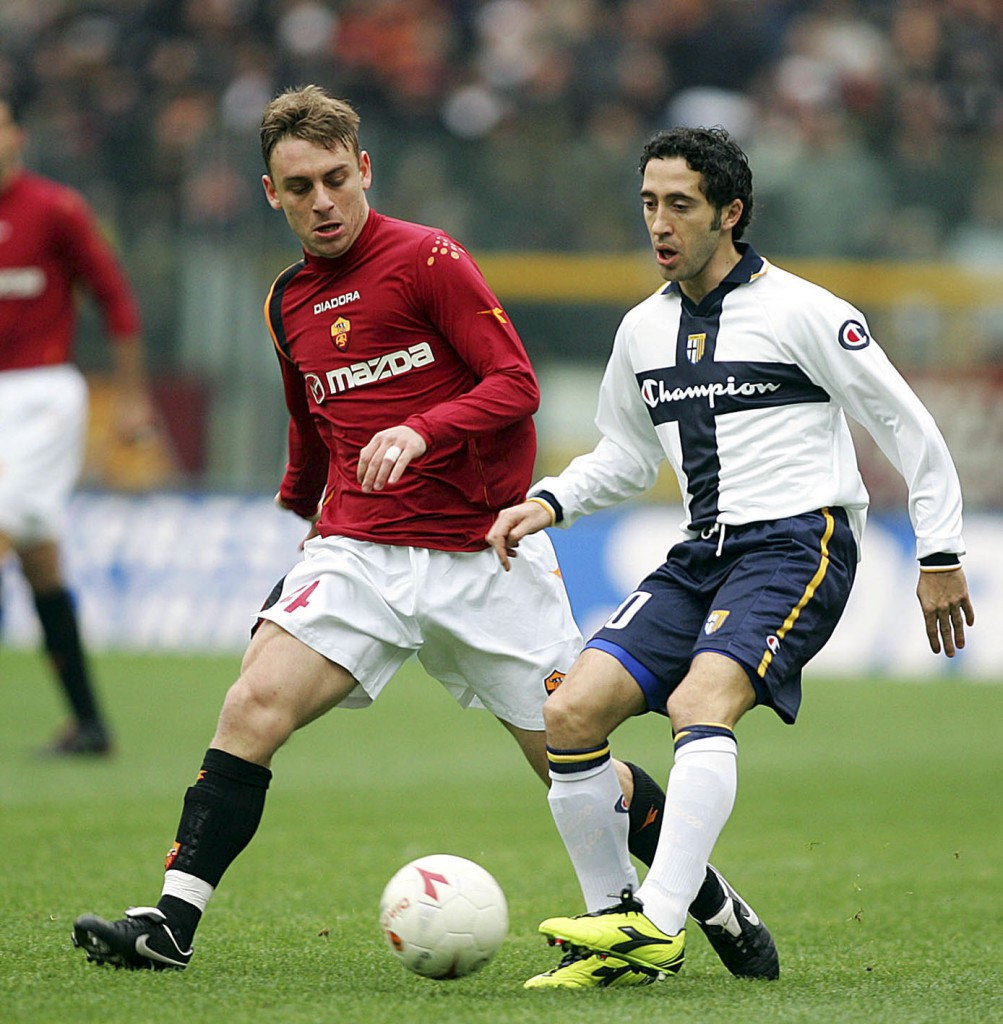ROME, ITALY - DECEMBER 19: Daniele de Rossi of Roma (L) and Domenico Morfeo of Parma in action during the Serie A match between Roma and and Parma at the Olympic stadium on December 19, 2004 in Rome, Italy. (Photo by Newpress/Getty Images)