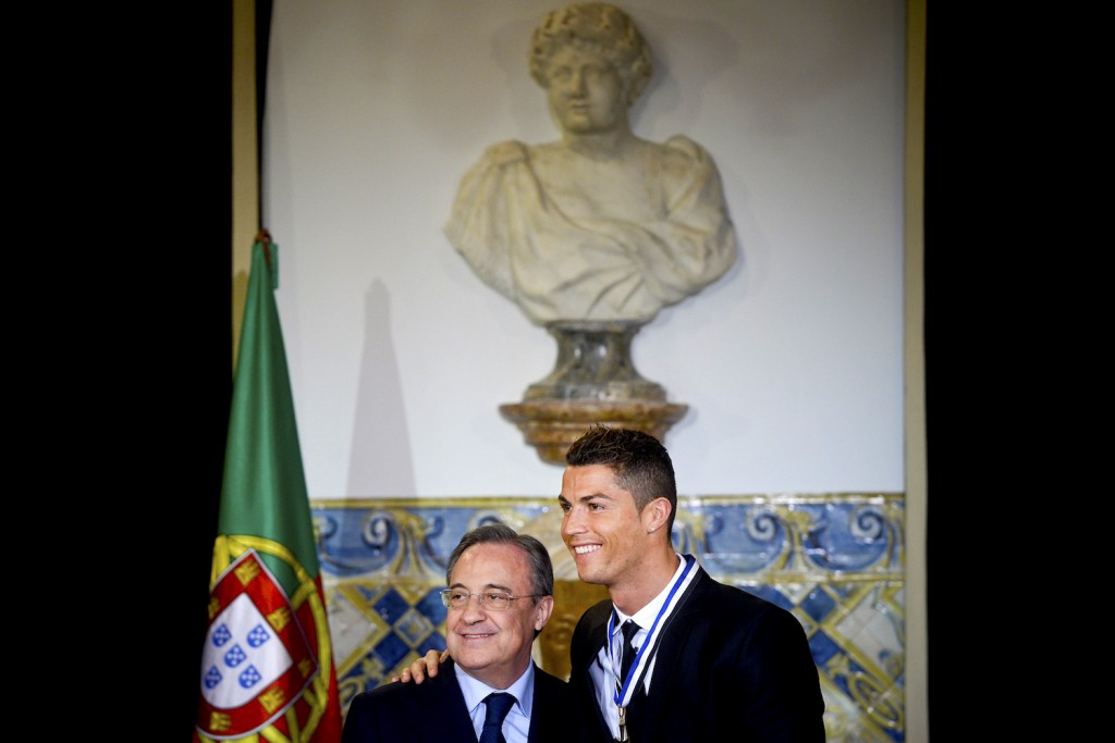 Portuguese forward Cristiano Ronaldo (R) poses with Real Madrid President Florentino Perez after being awarded by the Portuguese President Anibal Cavaco Silva (unseen) with the grade of Grand Officer of the Order of Prince Henry the Navigator during a ceremony held at Belem Palace on January 20, 2014. The portuguese president decided to distinguish Cristiano Ronaldo for being a worldwide symbol of Portugal, thus contributing towards the Country's international image, and an example of perseverance for the new generations. AFP PHOTO/ PATRICIA DE MELO MOREIRA (Photo credit should read PATRICIA DE MELO MOREIRA/AFP/Getty Images)