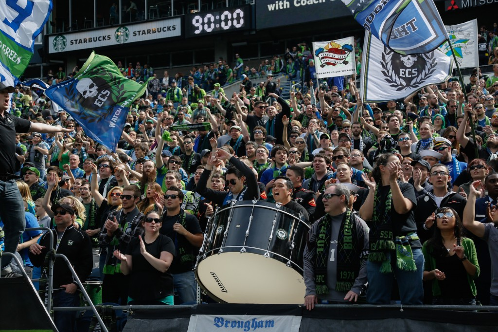 SEATTLE, WA - APRIL 26: Fans cheer during the match between the Seattle Sounders FC and the Colorado Rapids at CenturyLink Field on April 26, 2014 in Seattle, Washington. The Sounders defeated the Rapids 4-1. (Photo by Otto Greule Jr/Getty Images) *** Local Caption *** Fans