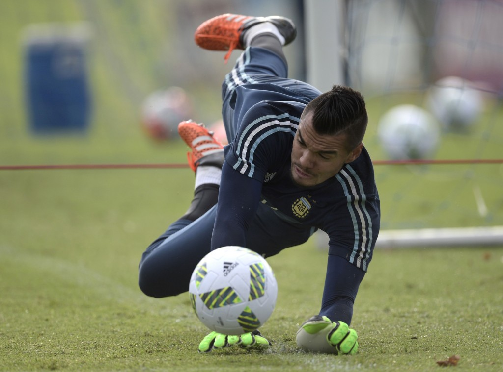 Argentina's goalkeeper Sergio Romero stops the ball during a training session in Ezeiza, Buenos Aires on March 21, 2016 ahead of a 2018 FIFA World Cup Russia South American qualifier football match against Chile to be held in Santiago on March 24. AFP PHOTO / JUAN MABROMATA / AFP / JUAN MABROMATA (Photo credit should read JUAN MABROMATA/AFP/Getty Images)