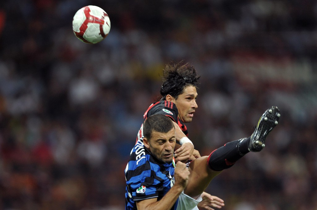 AC Milan's forward Marco Borriello (R) jumps for the ball with Inter Milan's Argentinian defender Walter Andrian Samuel during their Serie A football match AC Milan vs Inter Milan at San Siro Stadium in Milan on August 29, 2009. AFP PHOTO / GIUSEPPE CACACE (Photo credit should read GIUSEPPE CACACE/AFP/Getty Images)