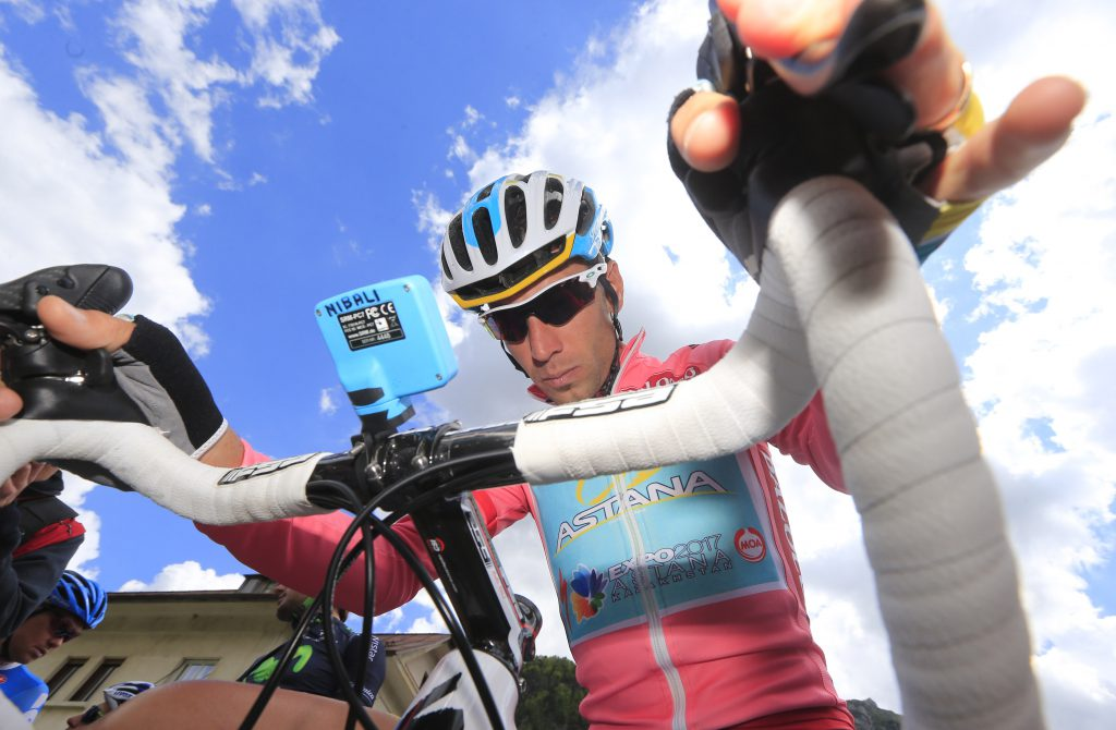 Italian cyclist Vincenzo Nibali wears the pink jersey as he prepares before the start of the 11th 184 km-long stage of the 96th Giro d'Italia from Tarvisio to Erto, on May 15, 2013, in Erto. AFP PHOTO / Luk Benies (Photo credit should read LUK BENIES/AFP/Getty Images)