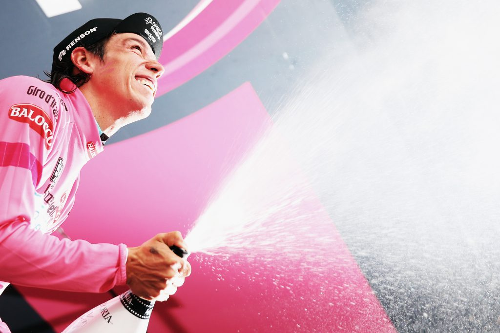 BAROLO, ITALY - MAY 22: Stage winner and new race leader and wearer of the Maglia Rosa Rigoberto Uran of Colombia and Omega Pharma-Quickstep celebrates and sprays prosecco on the podium after winning the twelfth stage of the 2014 Giro d'Italia, a 42km Individual Time Trial stage between Barbarasco and Barolo on May 22, 2014 in Barbarasco, Italy. (Photo by Bryn Lennon - Velo/Getty Images)