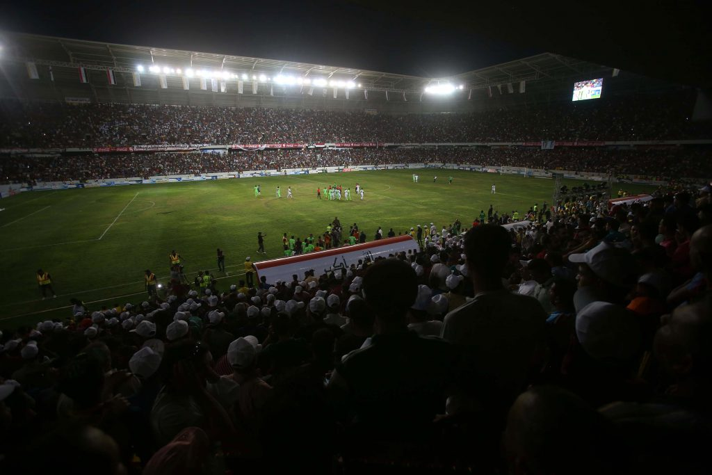 Iraqis attend a football match between the Iraqi national team and the Karbala club to celebrate the opening of the new Karbala International Stadium on May 12, 2016 in the holy Shiite city of Karbala. / AFP / Mohammed SAWAF (Photo credit should read MOHAMMED SAWAF/AFP/Getty Images)
