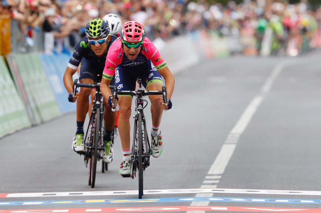 CORRECTION NATIONALITY OF THE RIDER - Italy's Diego Ulissi (front) of team Lampre-Merida sprints to win the 11th stage of the 99th Giro d'Italia, Tour of Italy, from Modena to Asolo on May 18, 2016. Ulissi won the stage ahead of Costa Rica's Andrey Amador of team Movistar and Pink jersey Luxembourg's rider Bob Jungels of Etixx - Quick Step. / AFP / Luk BENIES (Photo credit should read LUK BENIES/AFP/Getty Images)