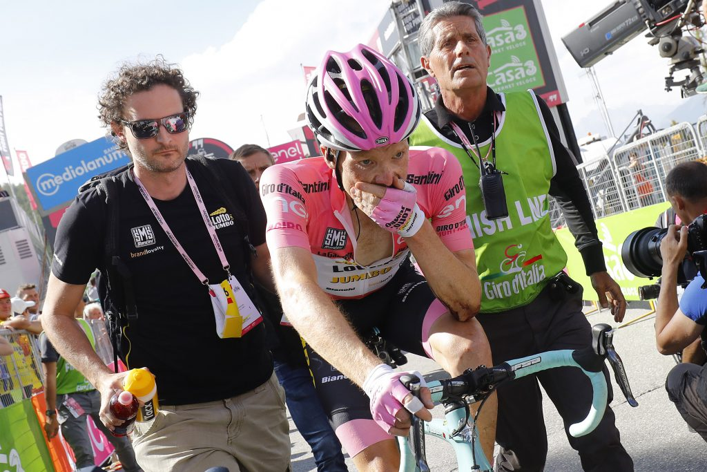 Pink jersey Dutch Steven Kruijswijk of team (Lotto NL) reacts after crossing the finish line of the 19th stage of the 99th Giro d'Italia, Tour of Italy, from Pinerolo to Risoul on May 27, 2016. Overnight leader Steven Kruijswijk finished almost five minutes off the pace after surviving a spectacular head-over-heels fall on the descent of the Col d'Agnel but then getting dropped badly on the last climb. Italy's Vincenzo Nibali of Astana escaped alone to a summit-finish victory in the 19th stage of the Giro d'Italia on Friday whilst Colombia's Esteban Chaves rode into the pink jersey by coming third on the day. / AFP / LUK BENIES (Photo credit should read LUK BENIES/AFP/Getty Images)