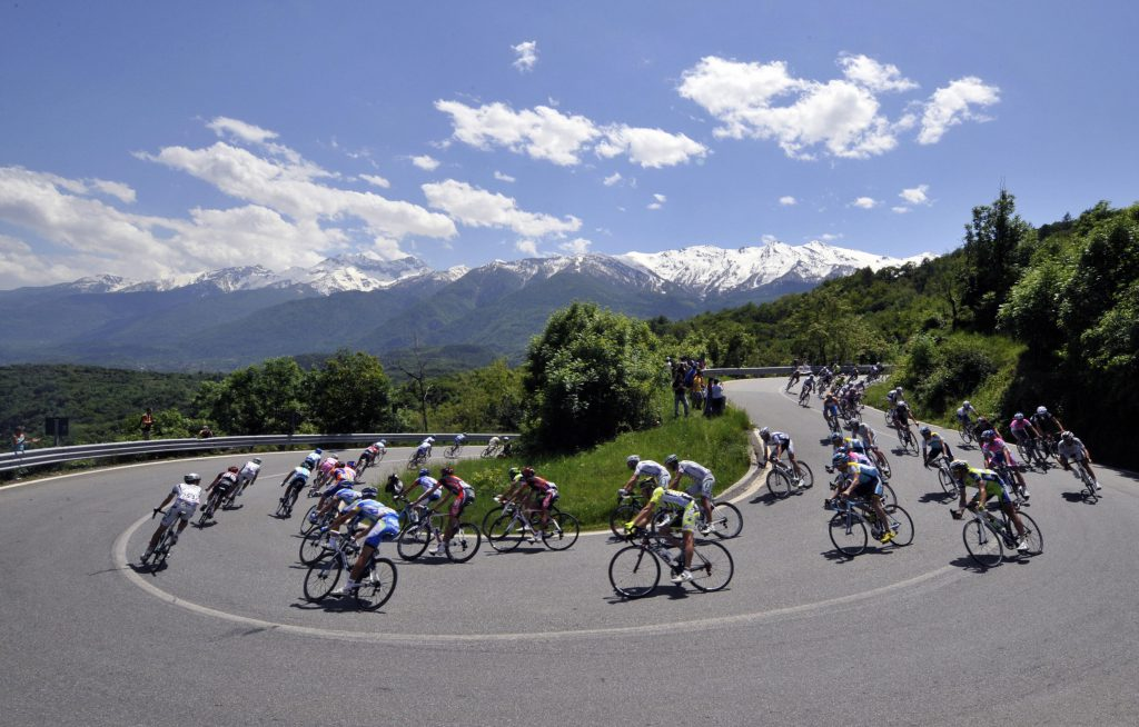 The pack rides during the tenth stage of 92nd Giro of Italy between Cuneo and Pinerolo on May 19, 2009. Italy's Daniele Di Luca (LPR/IRL) tightened his grip on the race leader's pink jersey by winning the 262km tenth stage after attacking on the descent of the Pra Martino climb and leaving all his rivals in his wake to take the victory in a little over six and a half hours. AFP PHOTO / DAMIEN MEYER (Photo credit should read DAMIEN MEYER/AFP/Getty Images)