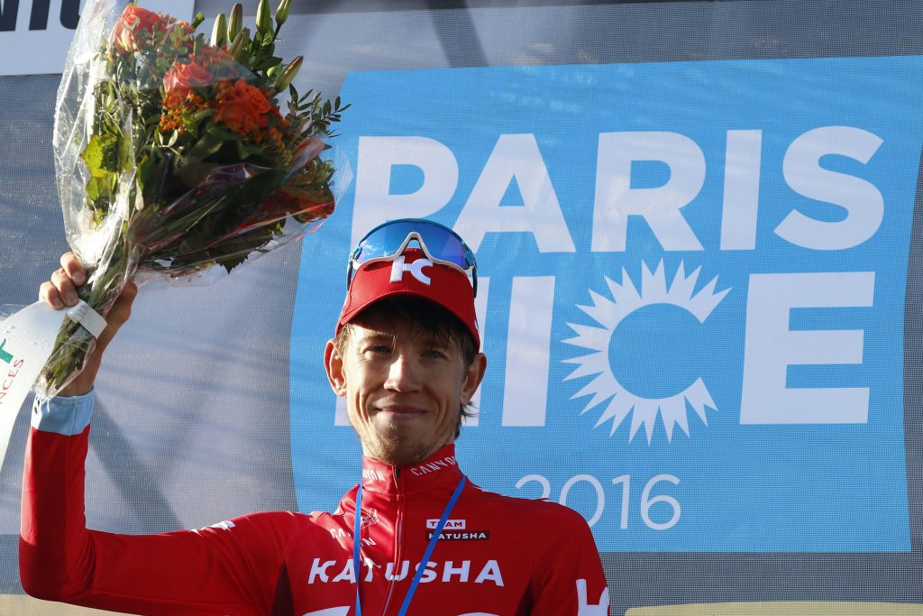 Russian Ilnur Zakarin celebrates on the podium after winning the 74th edition of the Paris-Nice cycling race between Nice and La Madone d'Utelle on March 12, 2016. / AFP / KENZO TRIBOUILLARD (Photo credit should read KENZO TRIBOUILLARD/AFP/Getty Images)