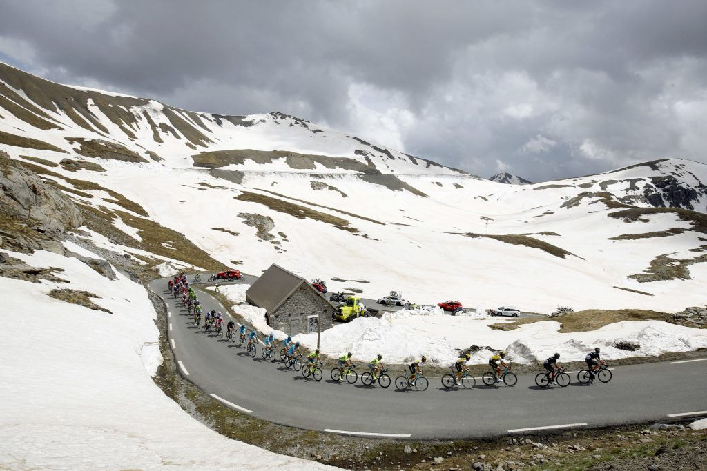 The peloton rides at the La Bonette pass (Col de la Bonette) during the 20th stage of the 99th Giro d'Italia, Tour of Italy, from Guillestre to Sant'Anna di Vinadio on May 28, 2016. Starting the day second at 44sec behind leader Esteban Chaves, Italian Vincenzo Nibali puts 1min 35sec into the Colombian to snatch the pink jersey. / AFP / LUK BENIES (Photo credit should read LUK BENIES/AFP/Getty Images)